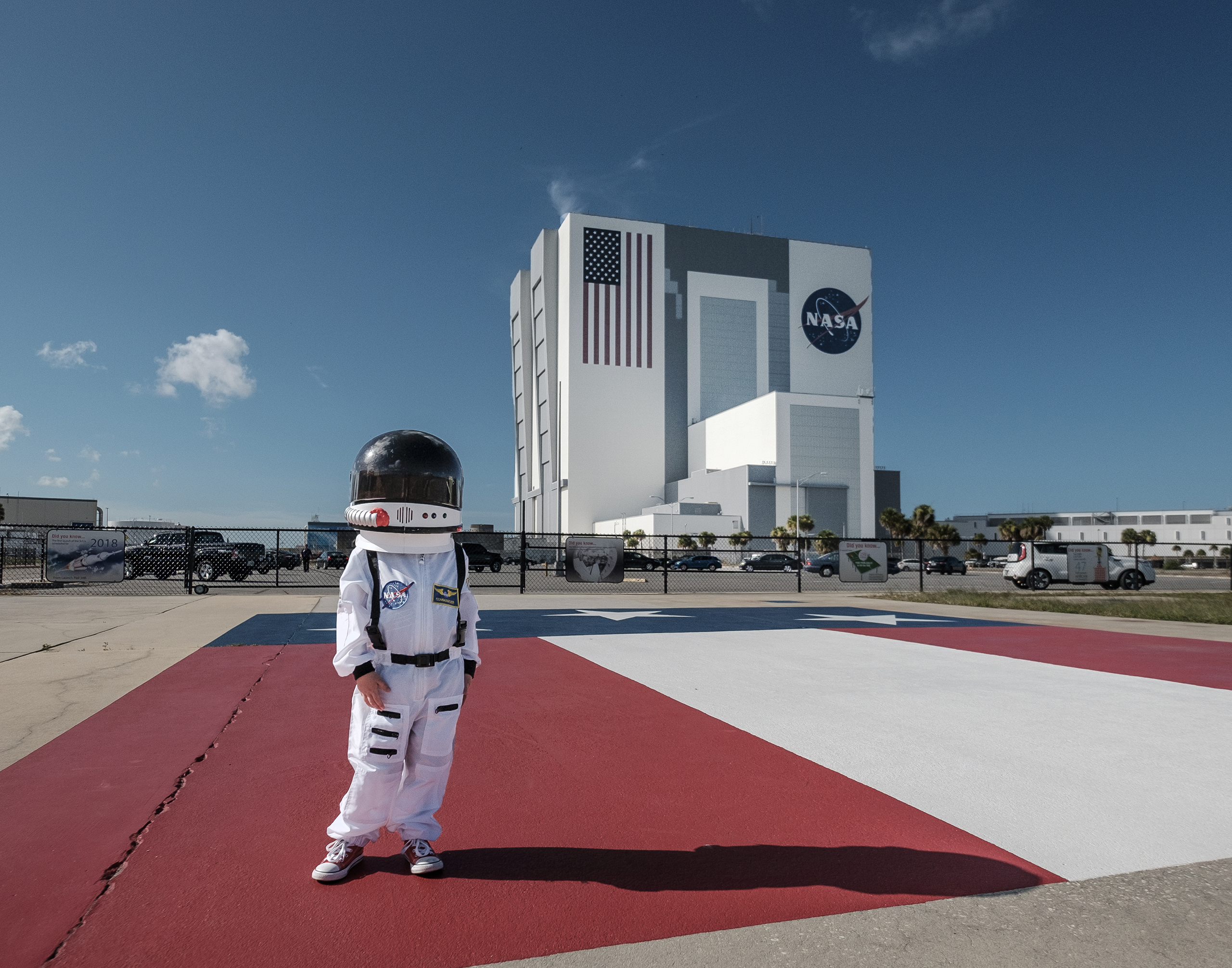 Harrison Sheldon stands on the Apollo gantry at the Kennedy Space Center, July 18, 2016.                                                              Harrison was invited to the Visitor center for a special visit as part of his father, Aaron Sheldon's, photography project Small Steps Are Giant Leaps.