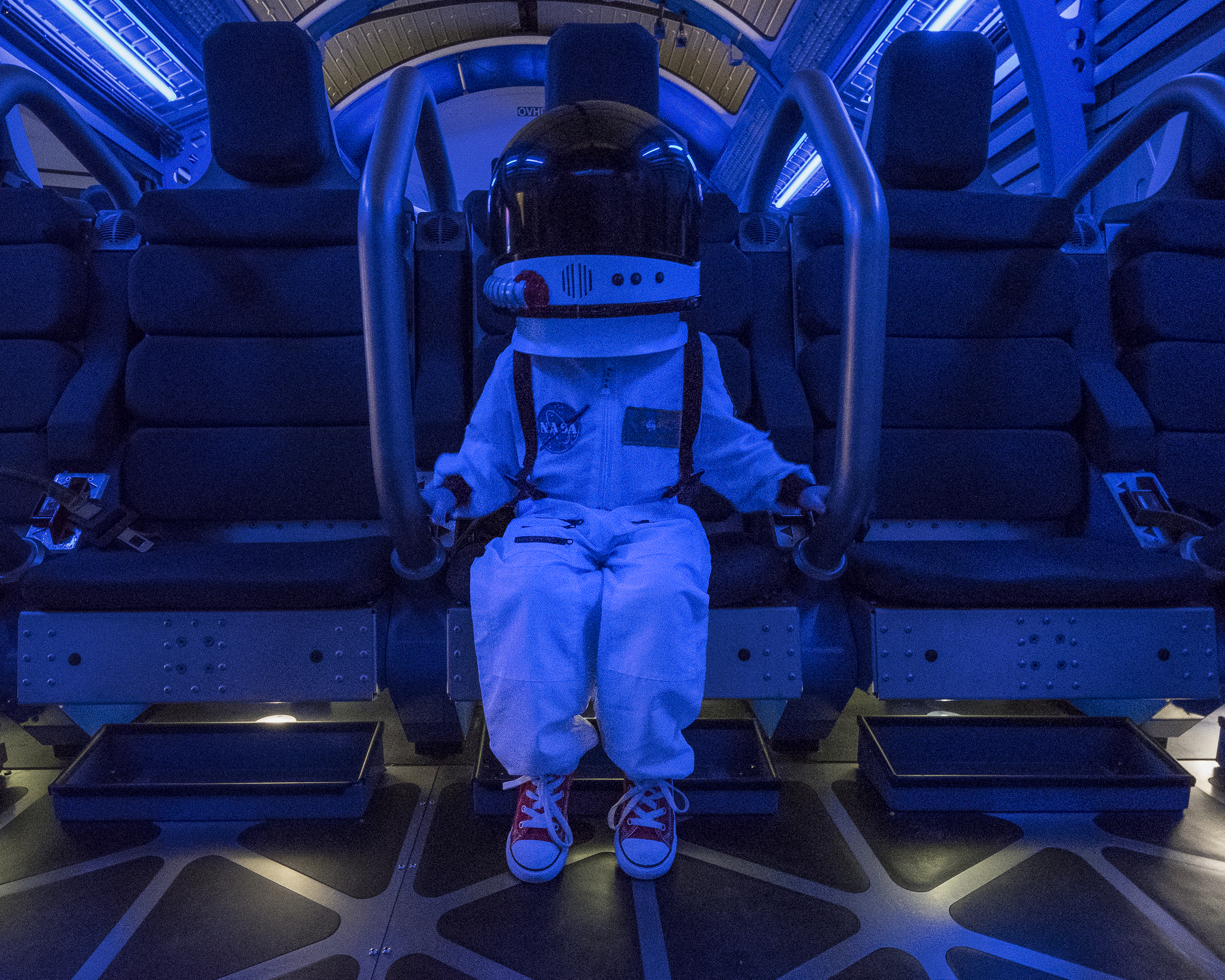 Harrison sits in the Kennedy Space Center's Shuttle Launch experience, July 19, 2016.