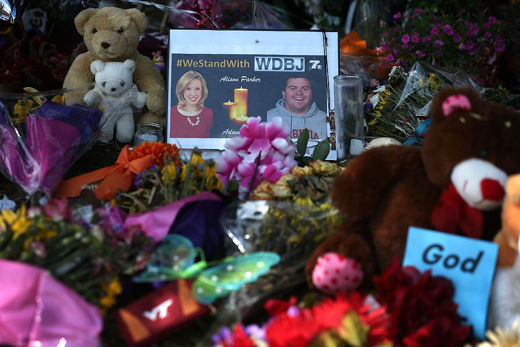 A picture of slain WDBJ photojournalists Adam Ward and Alison Parker is seen at a makeshift memorial outside the station September 1, 2015 in Roanoke, Virginia.