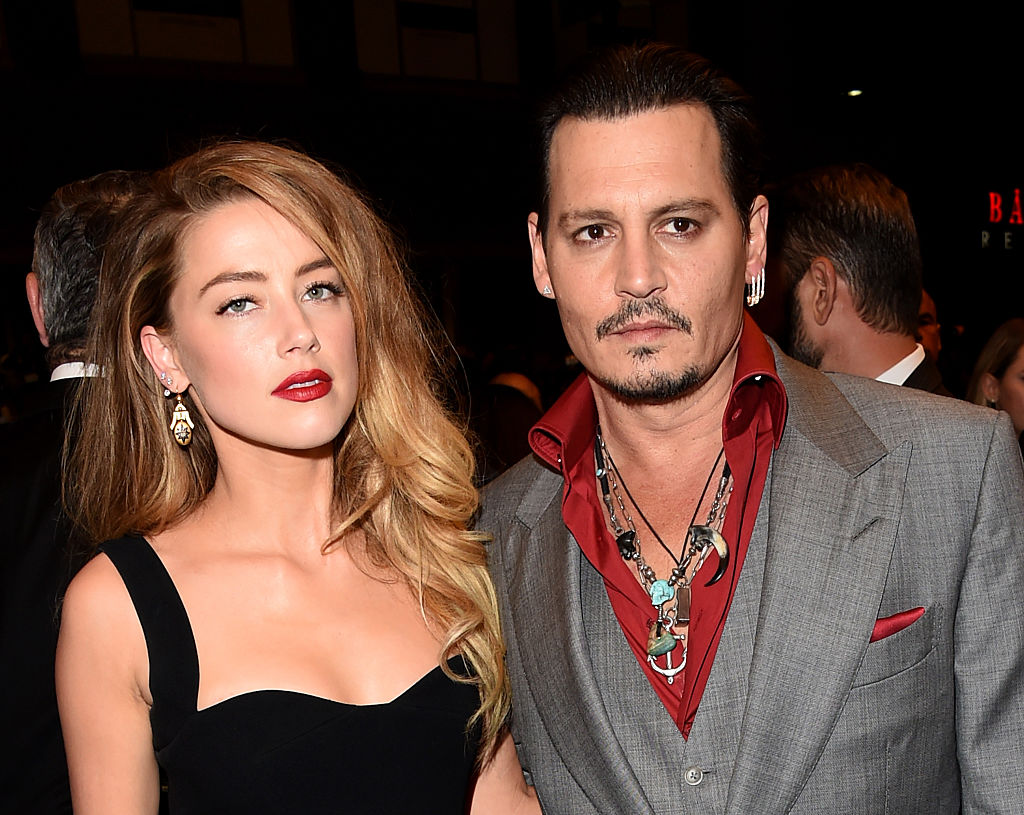 Actors Amber Heard (L) and Johnny Depp attend the  Black Mass  premiere during the 2015 Toronto International Film Festival at The Elgin on September 14, 2015 in Toronto, Canada.