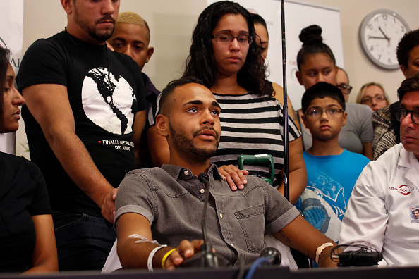 Gunshot victim Angel Colon, age 26, tells his story to the media at a press conference at Orlando Regional Medical Center on Tuesday,June 14, 2016.