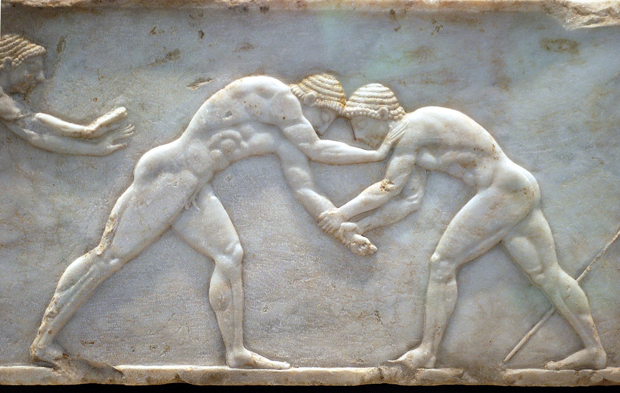 A marble sculpture of ancient Greek wrestlers from 510 BC is part of an exhibition at the National Archaeological Museum in Athens, July 15, 2004.