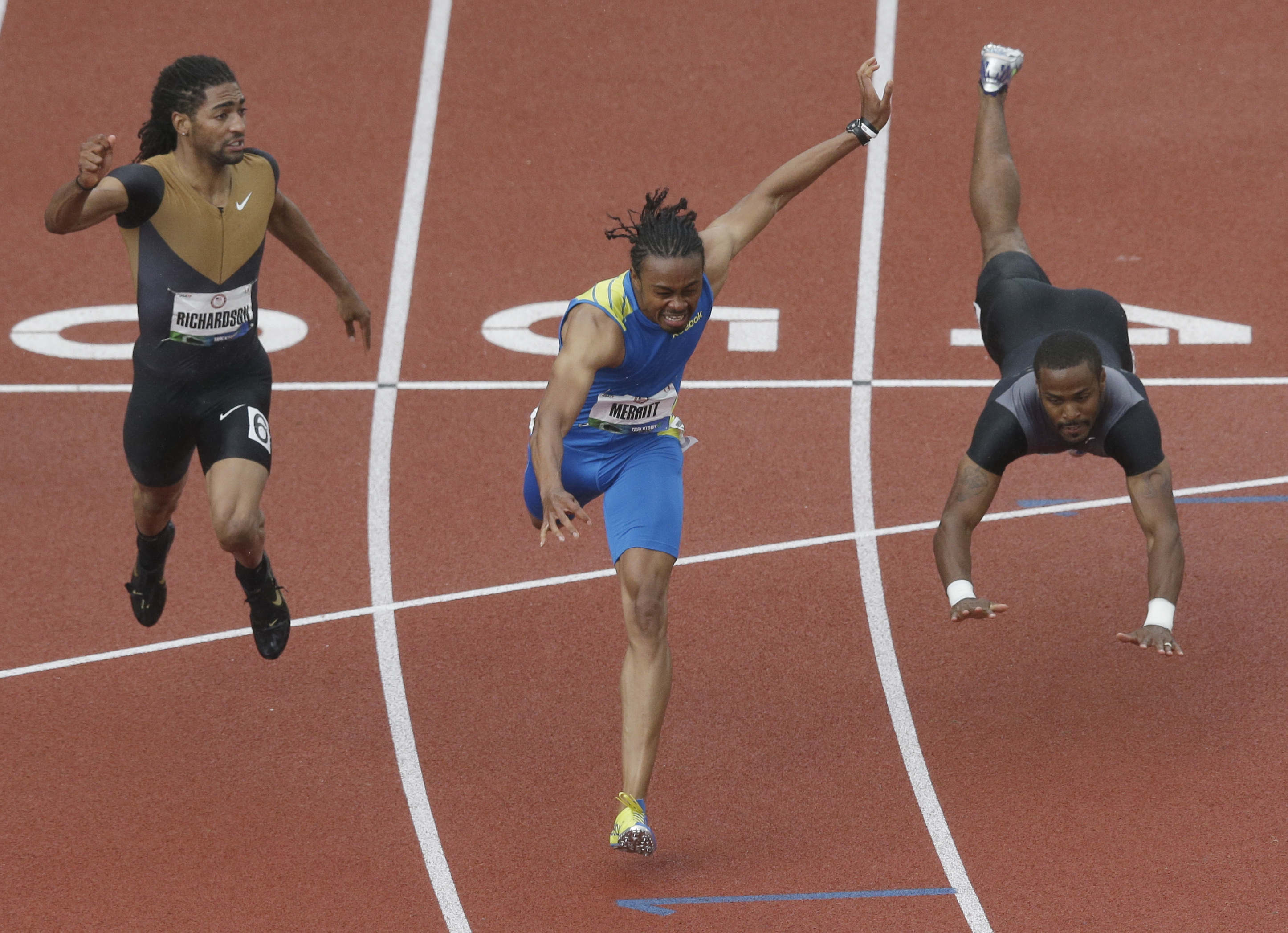 Jason Richardson and Aries Merritt lunge for the finish as Jeffrey Porter falls in the men's 110 meter hurdles at the U.S. Olympic Track and Field Trials Saturday, June 30, 2012, in Eugene, Ore. (AP Photo/Charlie Riedel)