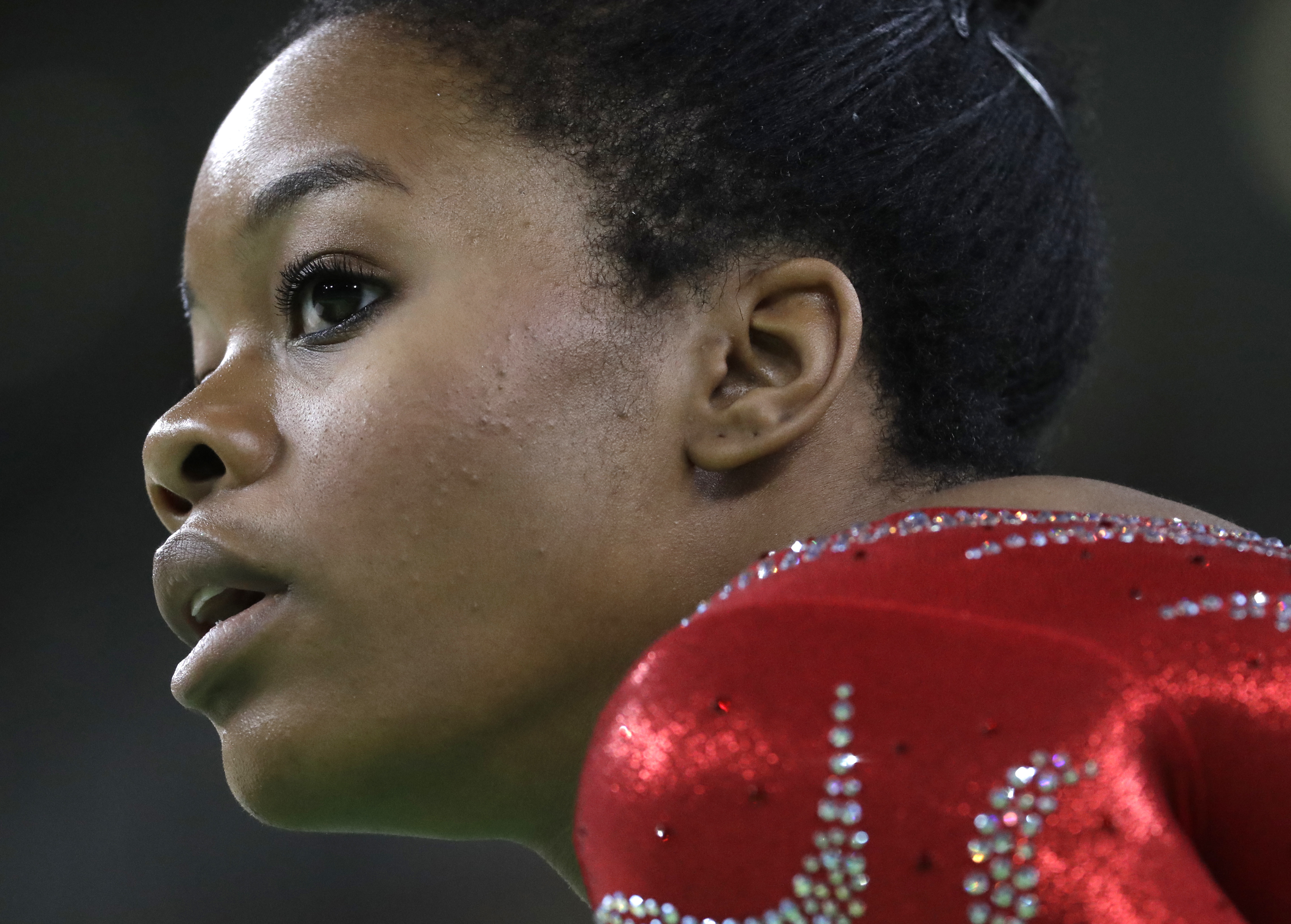 Gabrielle Douglas rests after her floor routine during the artistic gymnastics women's qualification at the 2016 Summer Olympics in Rio de Janeiro on Aug. 7, 2016.