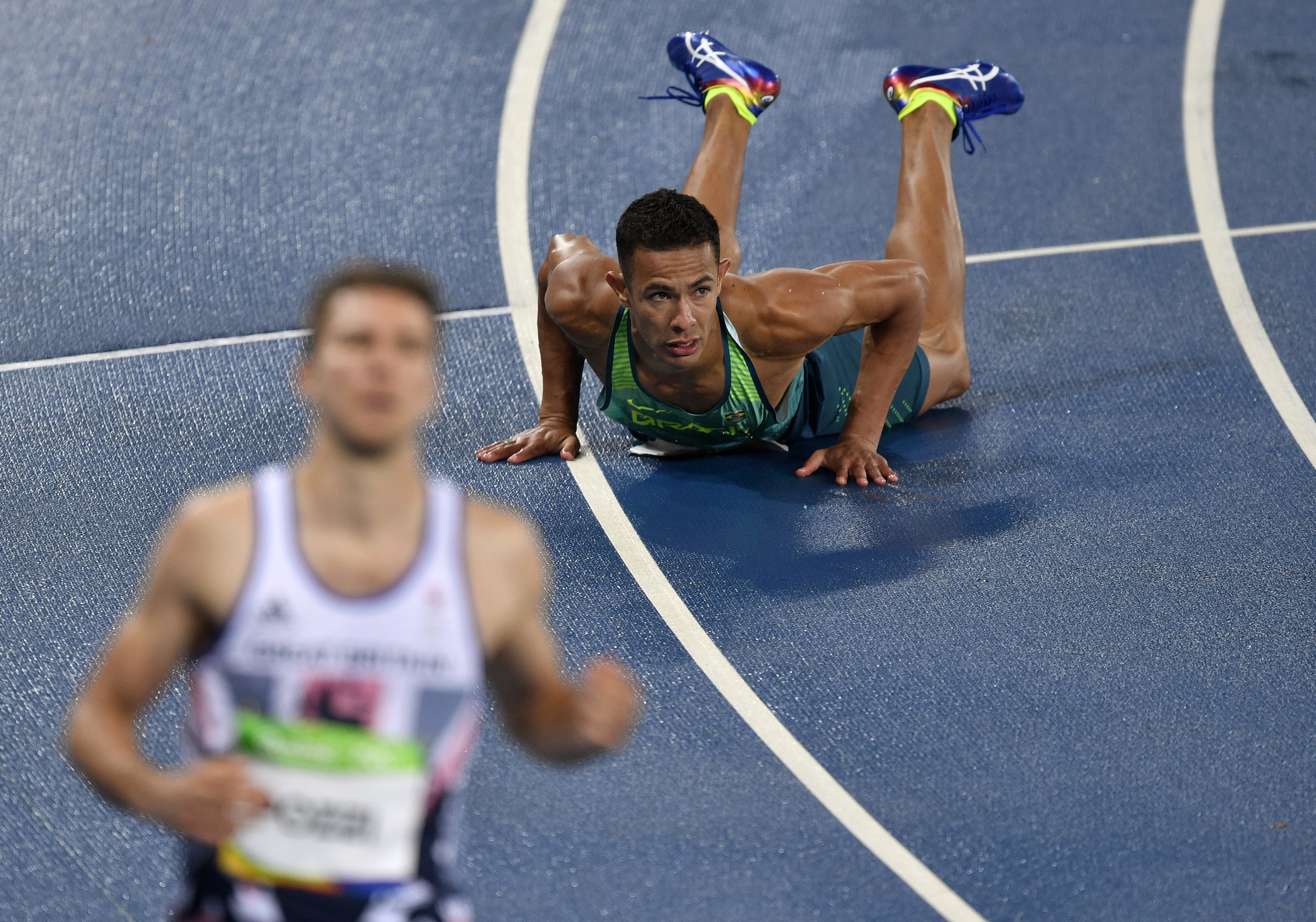 Britain's Andrew Pozzi and Brazil's Joao Vitor De Oliveira, right, compete in a men's 110-meter hurdles heat during the athletics competitions of the 2016 Summer Olympics at the Olympic stadium in Rio de Janeiro, Brazil, Monday, Aug. 15, 2016. (AP Photo/Martin Meissner)