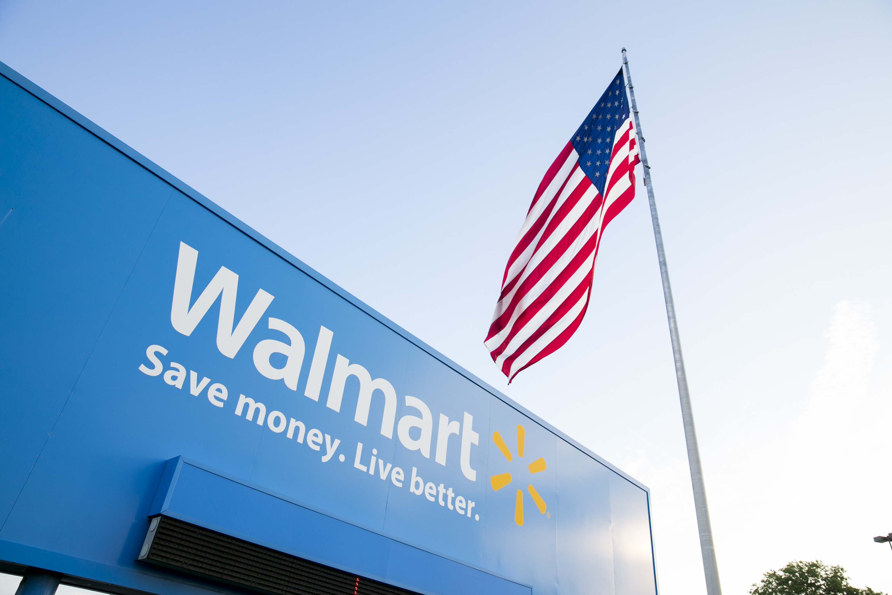 A logo sign outside of the Walmart headquarters, known as the Home Office, in Bentonville, Arkansas on August 18, 2015.