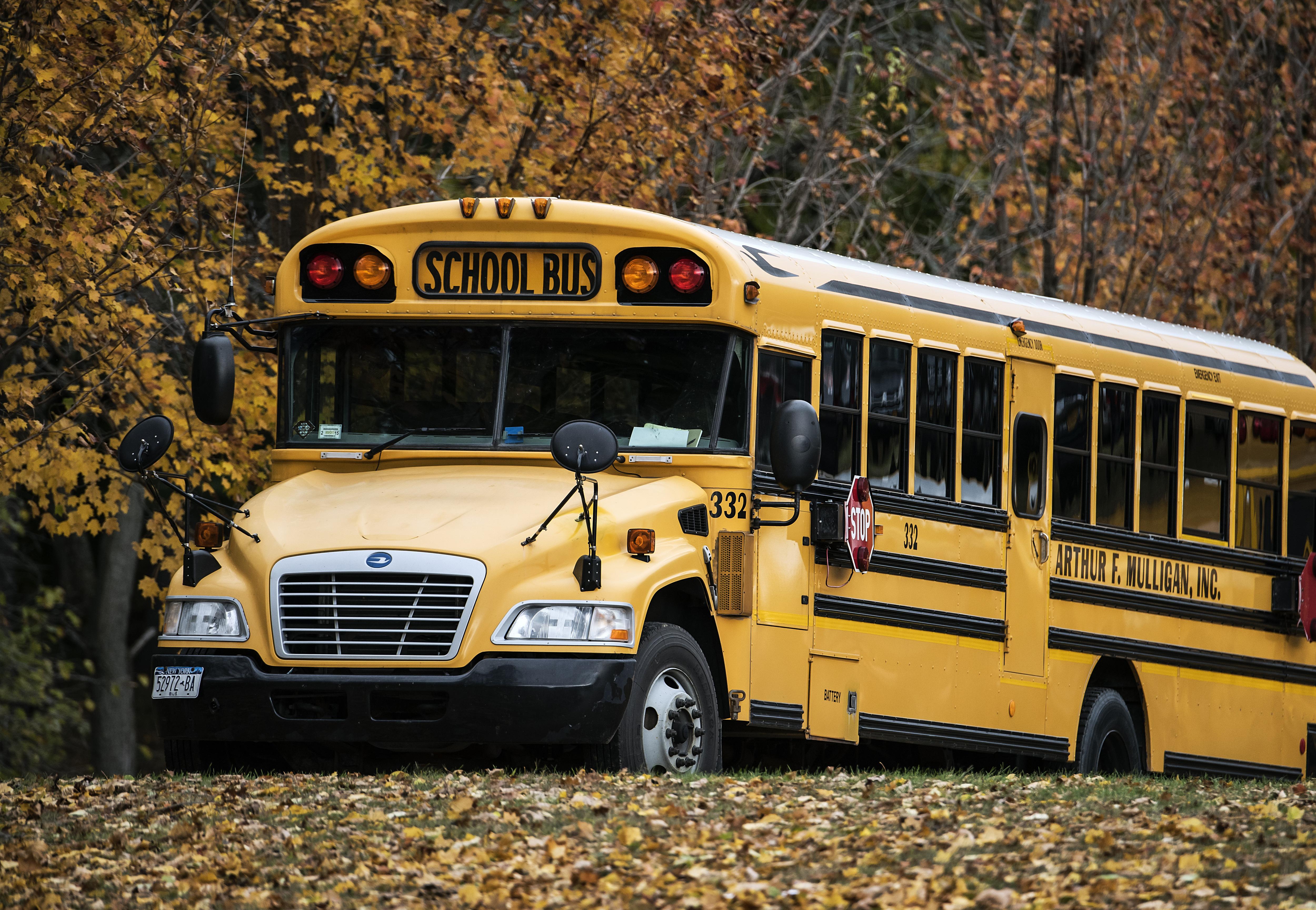 School bus on rural autumn route.