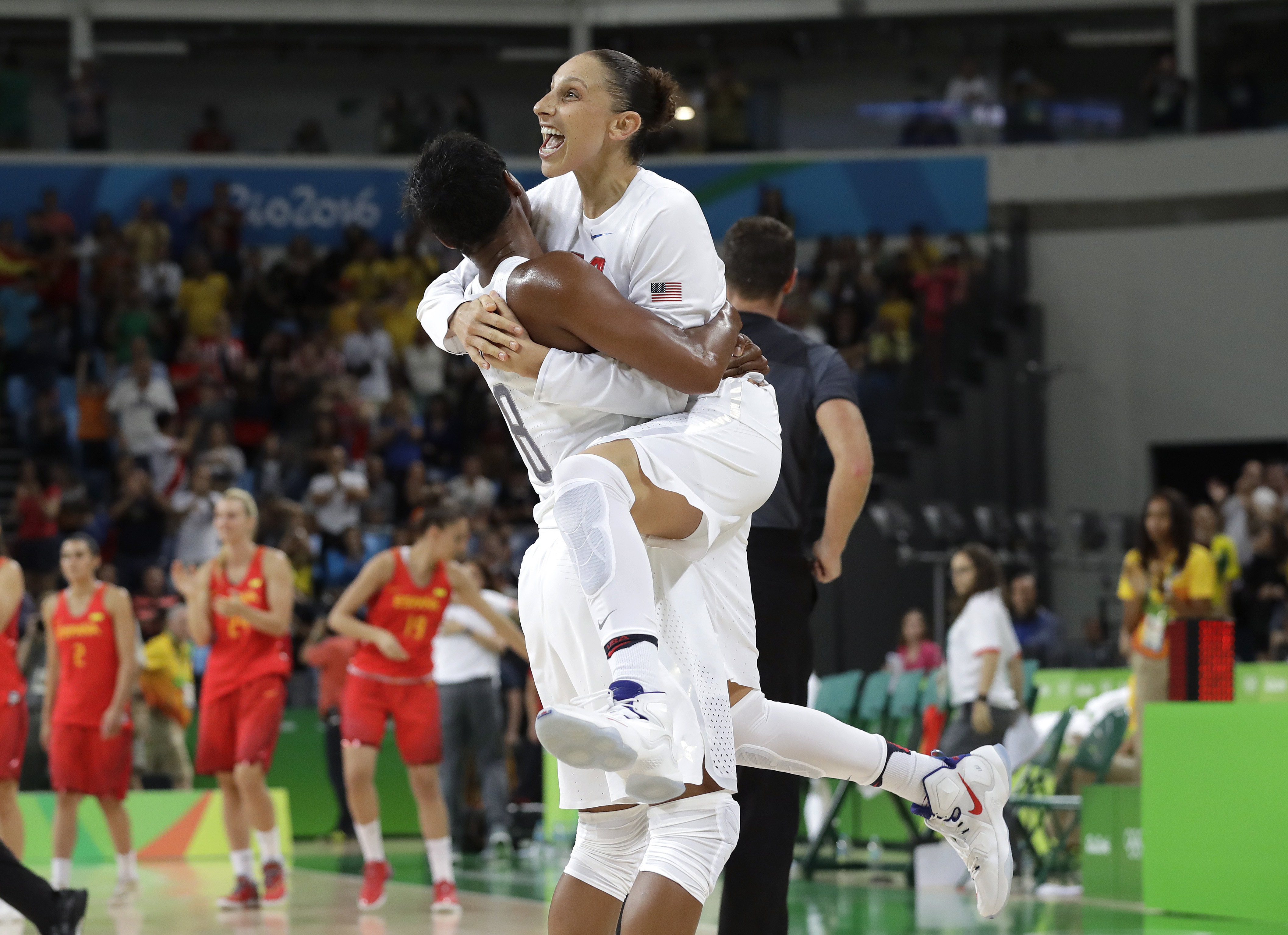 Diana Taurasi leaps into the arms of teammate Angel McCoughtry as they celebrate their win over Spain in a women's gold medal basketball game at the 2016 Summer Olympics, on Aug. 20, 2016.