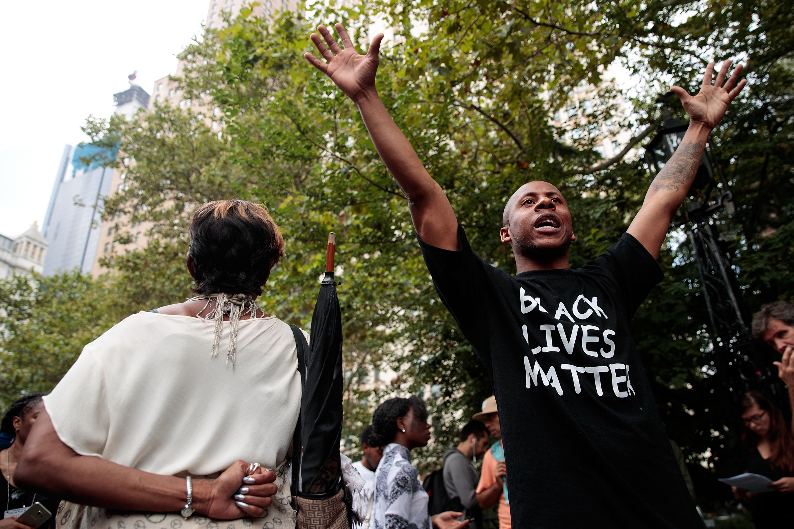 People rally during a protest against police brutality at City Hall Park in New York City on Aug. 1, 2016.