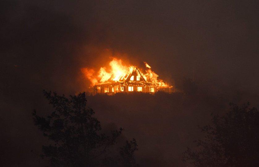 A house burns on a hill near Cajon Junction, Calif., Aug. 16, 2016.