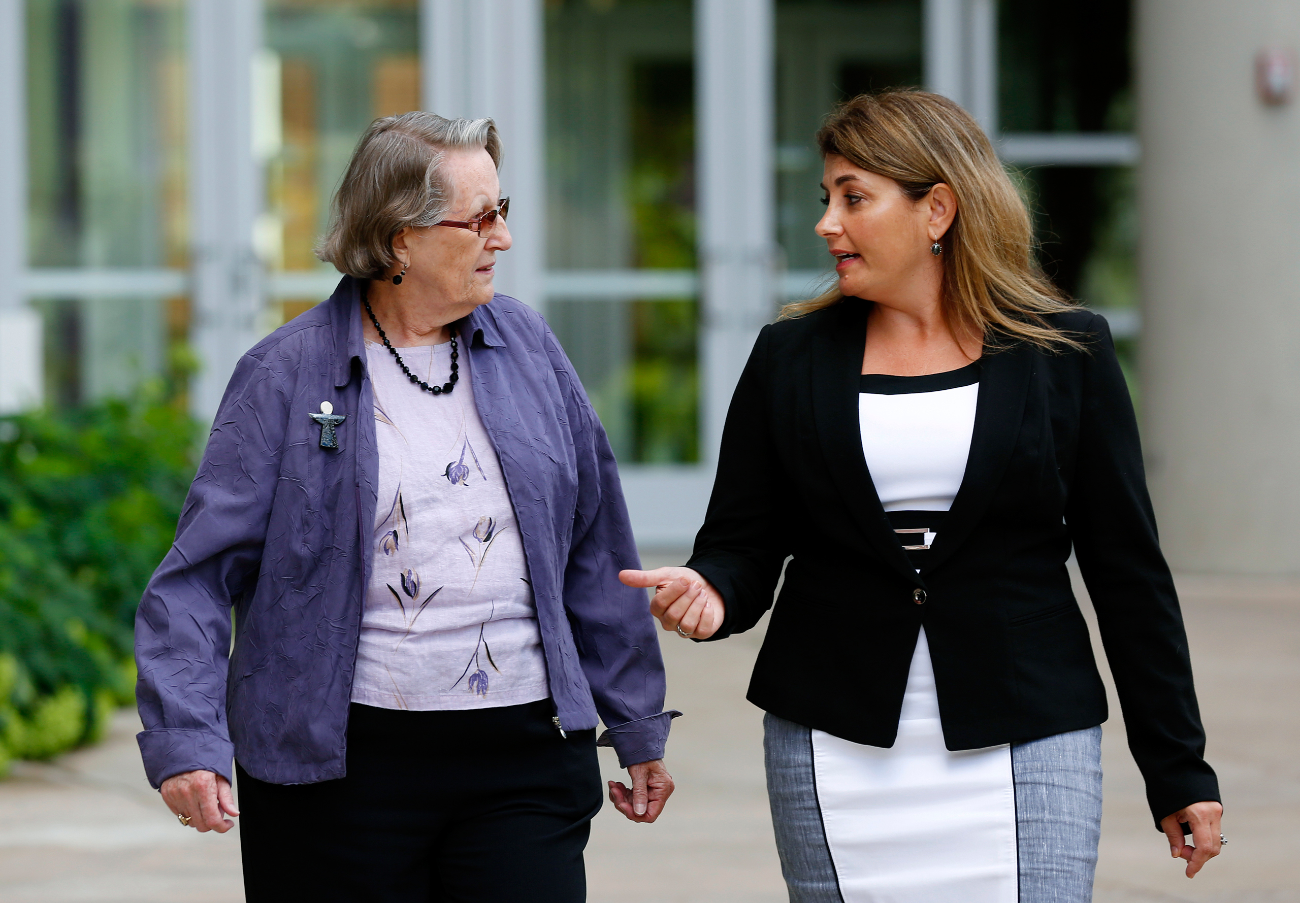 Angela McArthur, right, director of the Anatomy Bequest Program at the University of Minnesota Medical School, walks with Jean Larson, widow of a donor, in Minneapolis on Aug. 11, 2016.