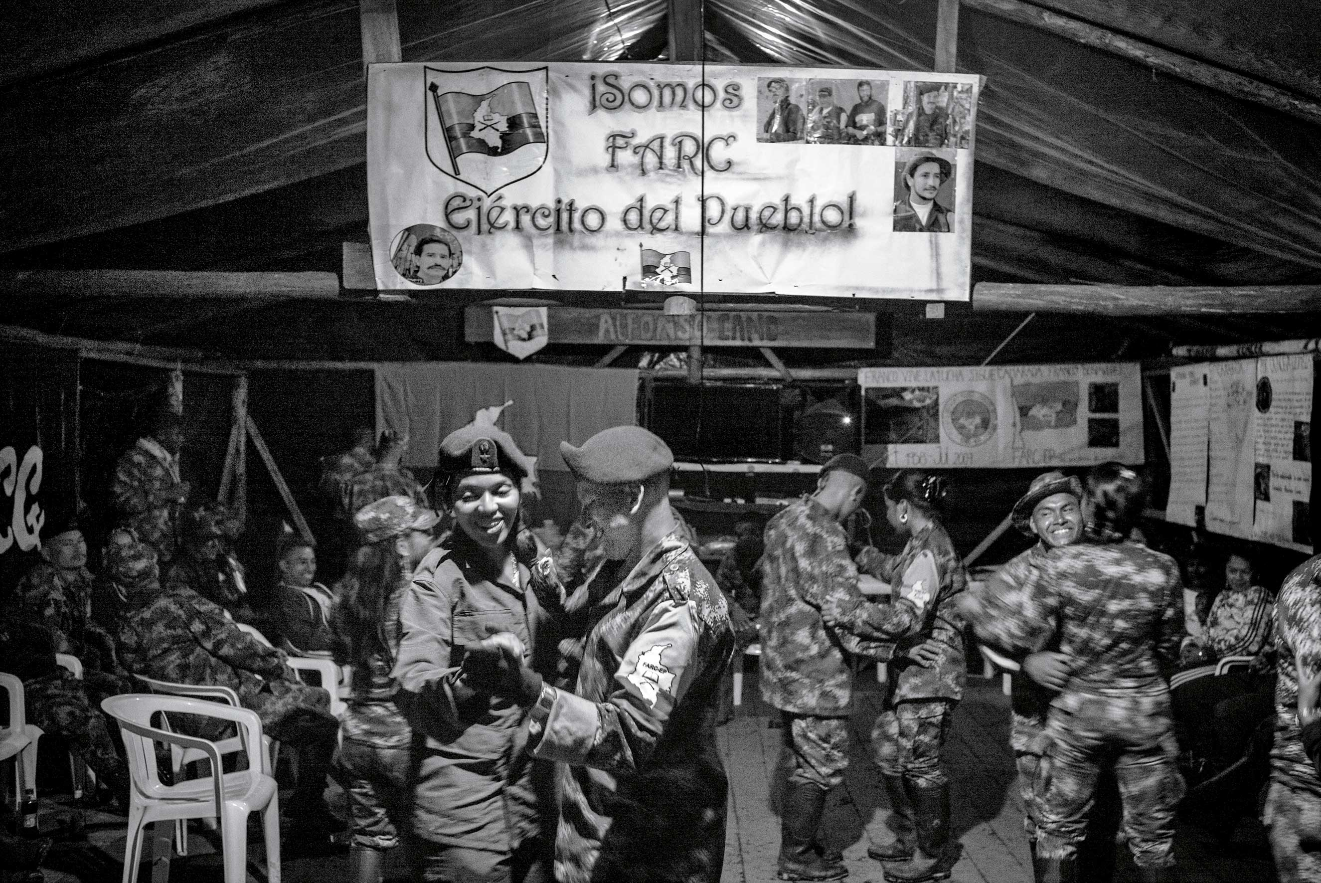 Male and female FARC fighters dance during a party in July at one of their camps in rural Colombia