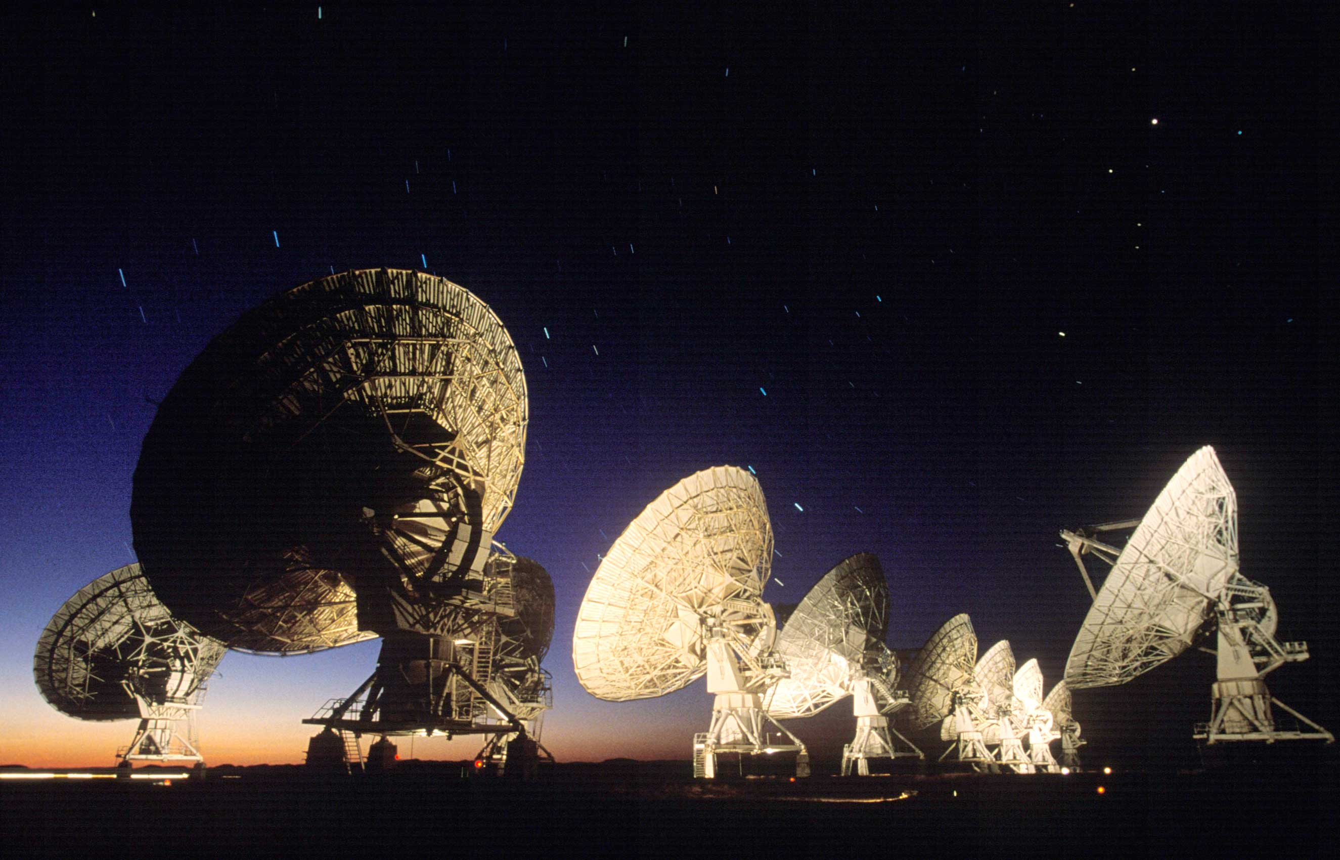 Radio telescopes like the Very Large Array in New Mexico scan the skies