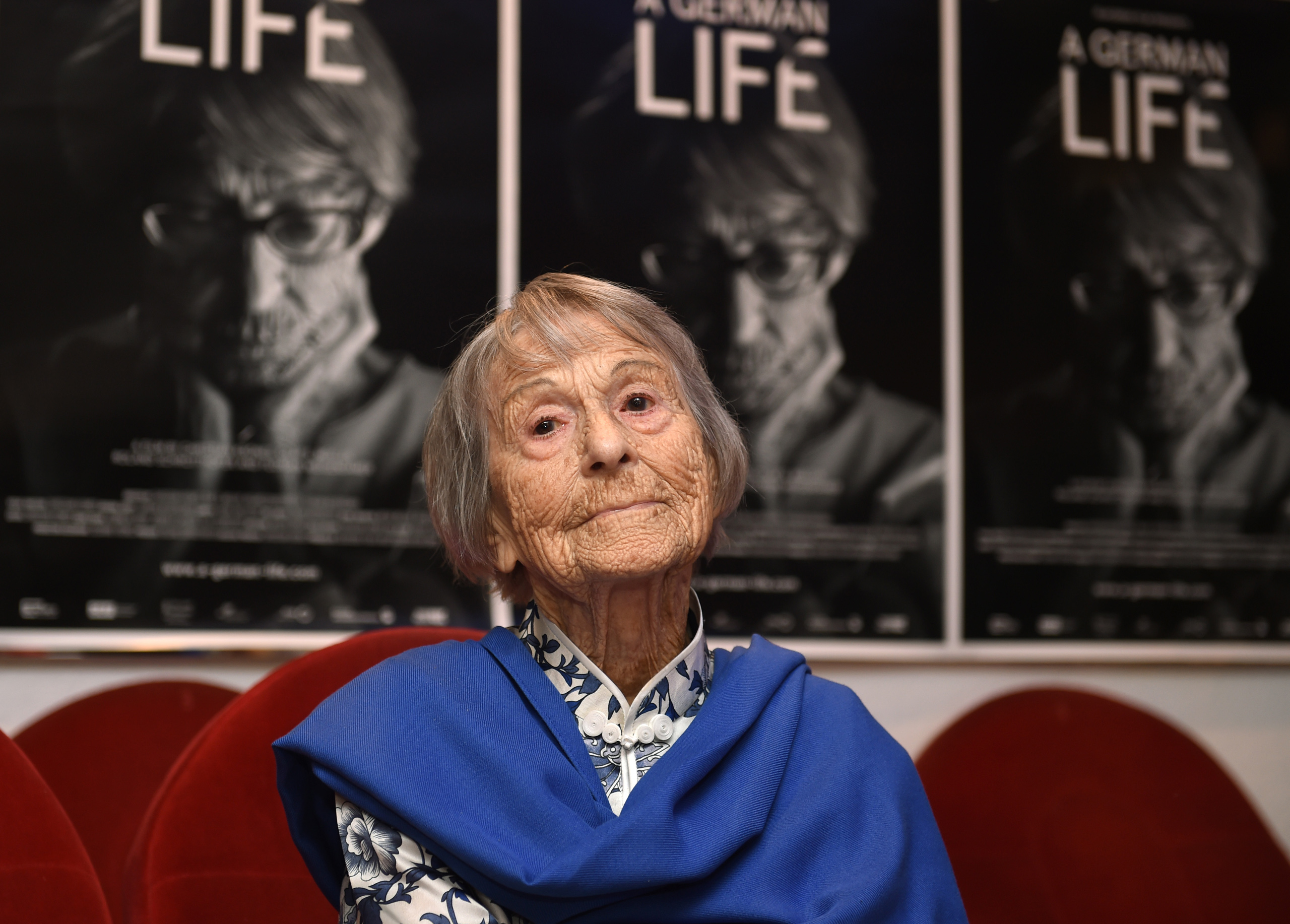 Brunhilde Pomsel, former secretary of Nazi propaganda chief Joseph Goebbels, sits on a cinema chair in front of posters for the movie  A German life  in a cinema in Munich, southern Germany, on June 29, 2016.