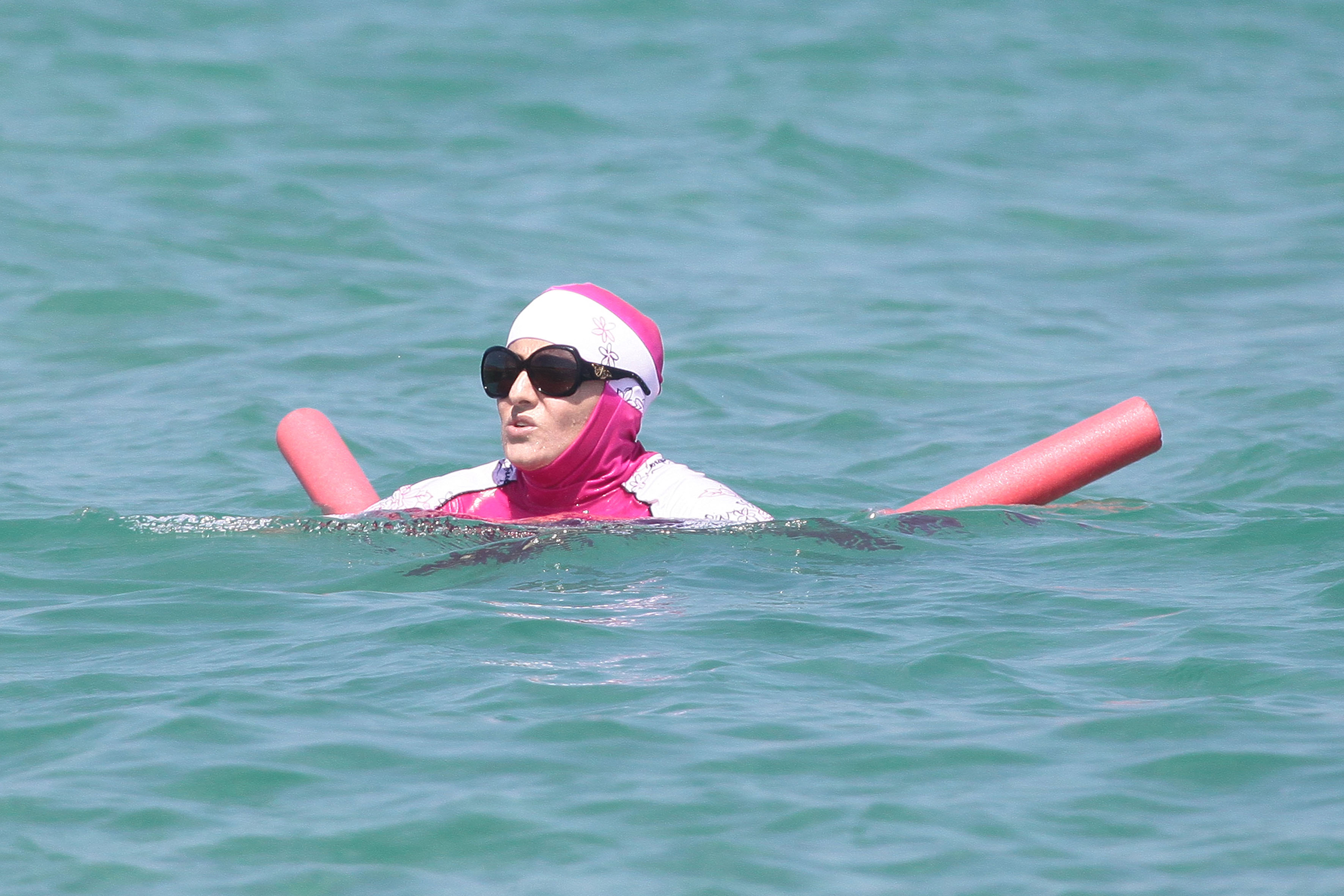 A woman wearing a burkini takes a dip in the south of France on Aug. 15, 2016.