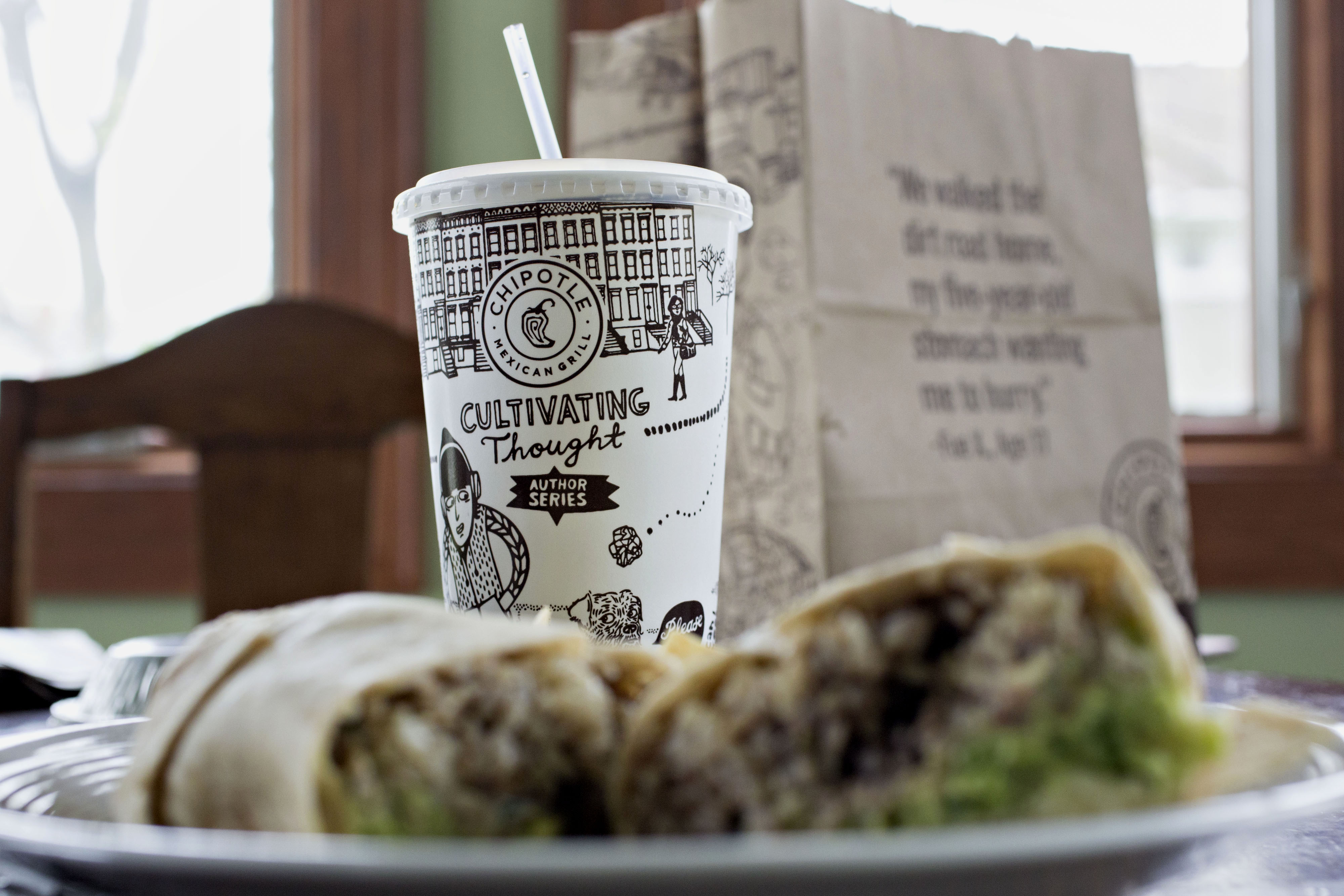 Chipotle Mexican Grill Inc. take-out food is arranged for a photograph in Tiskilwa, Illinois, U.S., on Friday, April 22, 2016. Chipotle Mexican Grill Inc. is expected to release earnings figures on April 26.