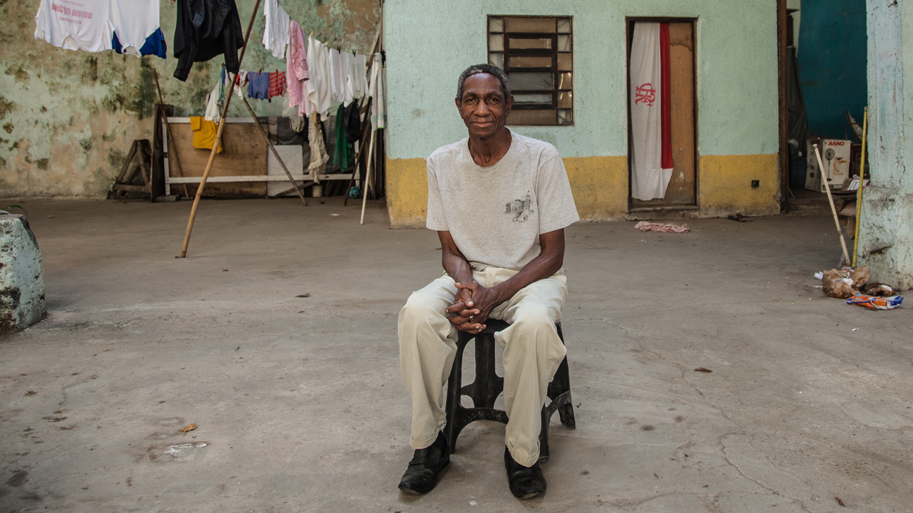 Paulo Cezar de Paula, 62, sitting in the abandoned warehouse he has been squatting for three years in the port area of Rio de Janeiro, on July 25, 2016.