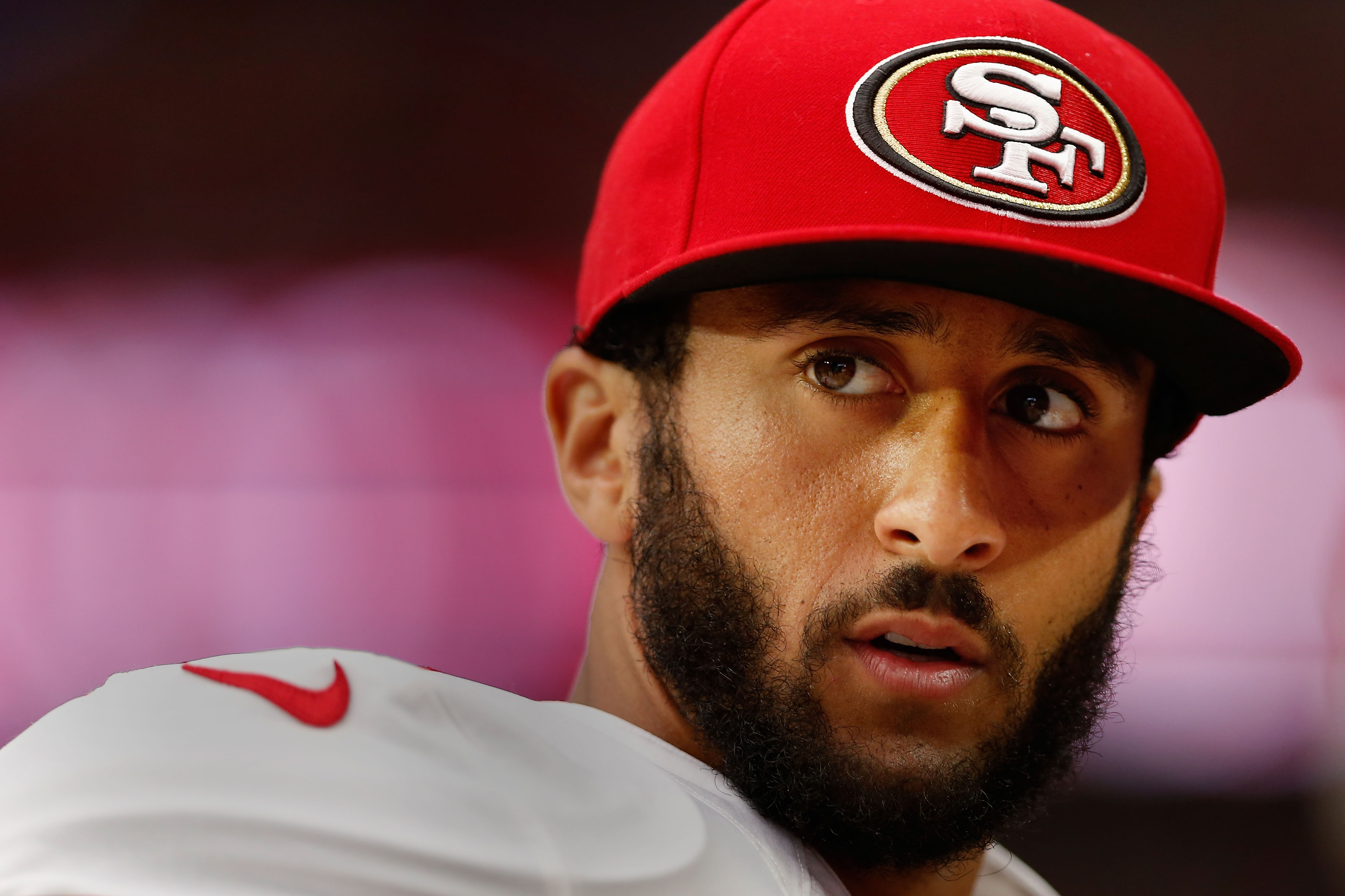 Quarterback Colin Kaepernick #7 of the San Francisco 49ers watches from the sidelines during the NFL game against the Arizona Cardinals at the University of Phoenix Stadium on Sept. 27, 2015 in Glendale, Arizona.