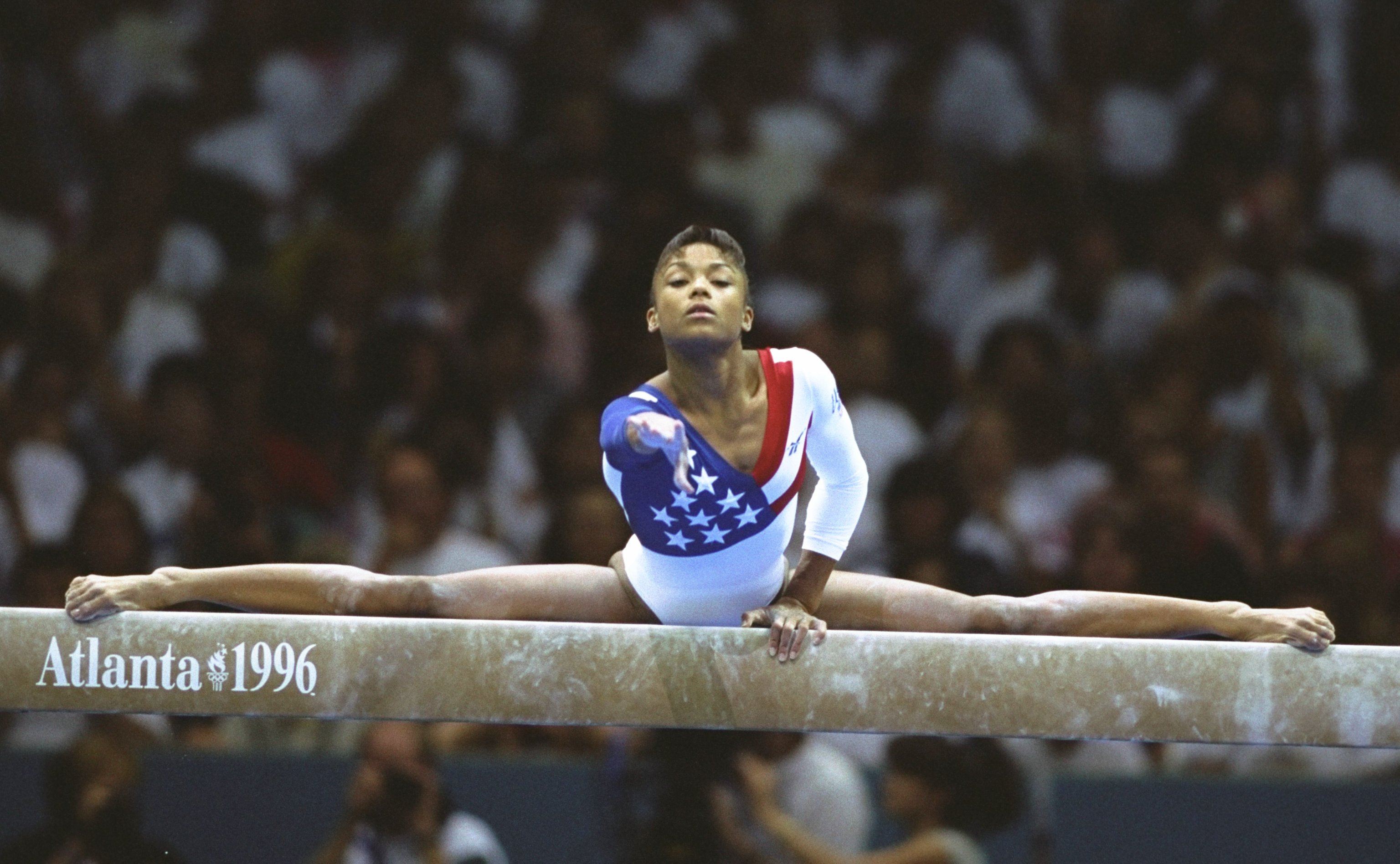 Dominique Dawes of the USA on the beam during the womens team gymnastics event at the Georgia Dome at the 1996 Centennial Olympic Games in Atlanta on July 23, 1996.
