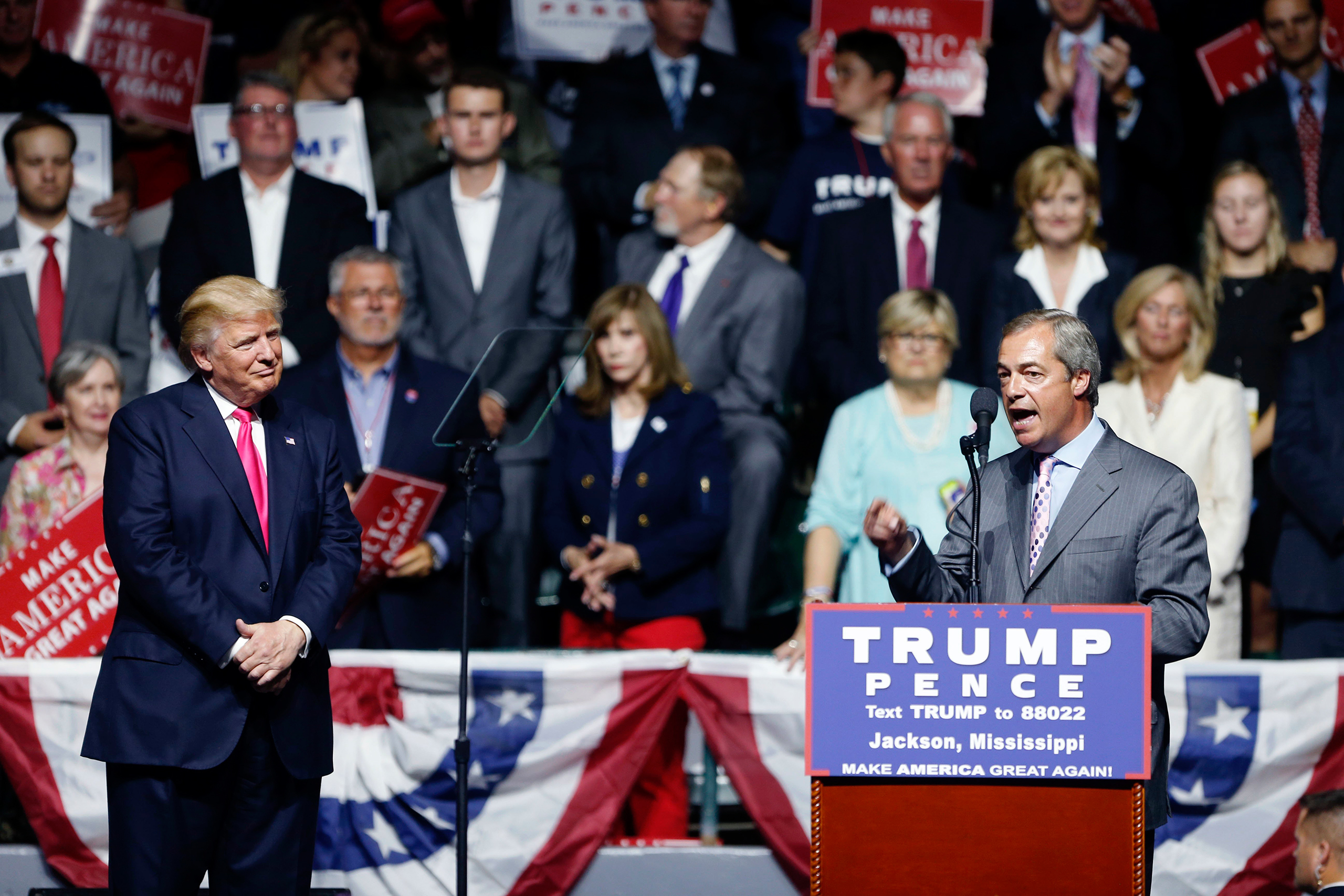 Nigel Farage, ex-leader of the British UKIP party, speaks as Republican presidential candidate Donald Trump listens at Trump's campaign rally in Jackson, Miss., on Aug. 24, 2016.