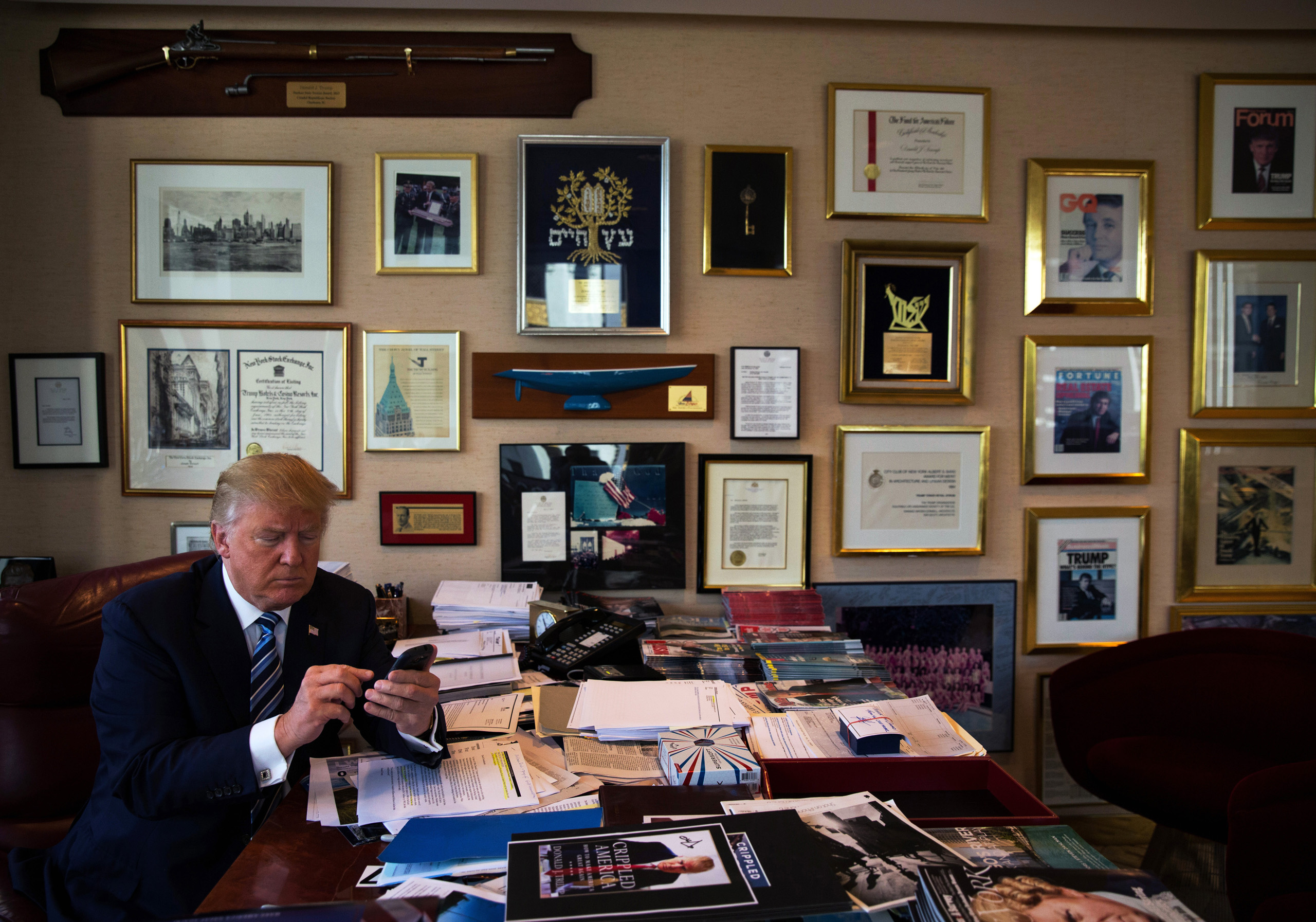 Donald Trump demonstrates how he Tweets using his Samsung phone in his office in the Trump Tower in New York City on Sept. 29, 2015.