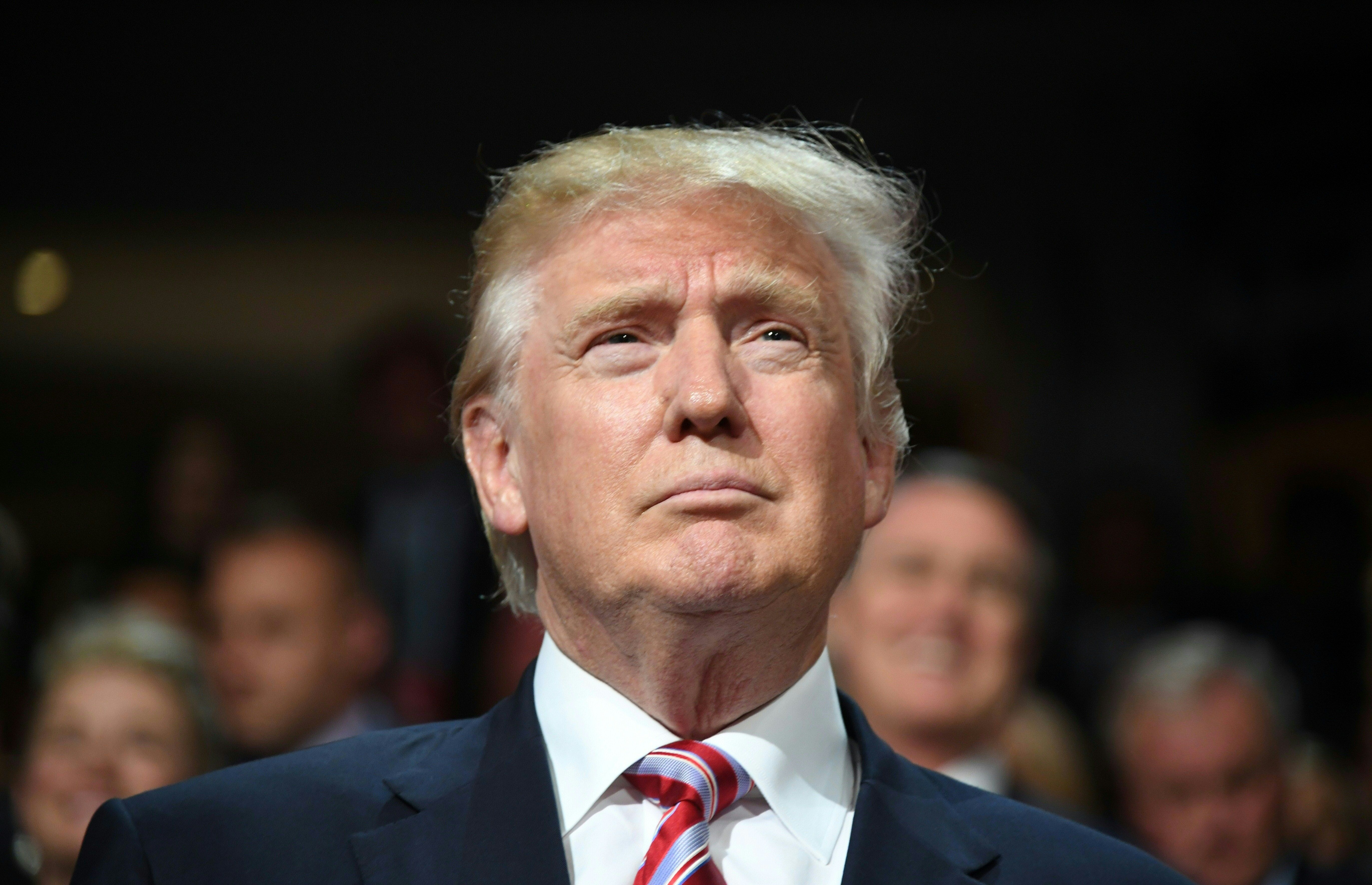 Republican presidential candidate Donald Trump is seen on day three of the Republican National Convention at the Quicken Loans Arena in Cleveland, Ohio on July 20, 2016.                                           / AFP / Jim WATSON        (Photo credit should read JIM WATSON/AFP/Getty Images)