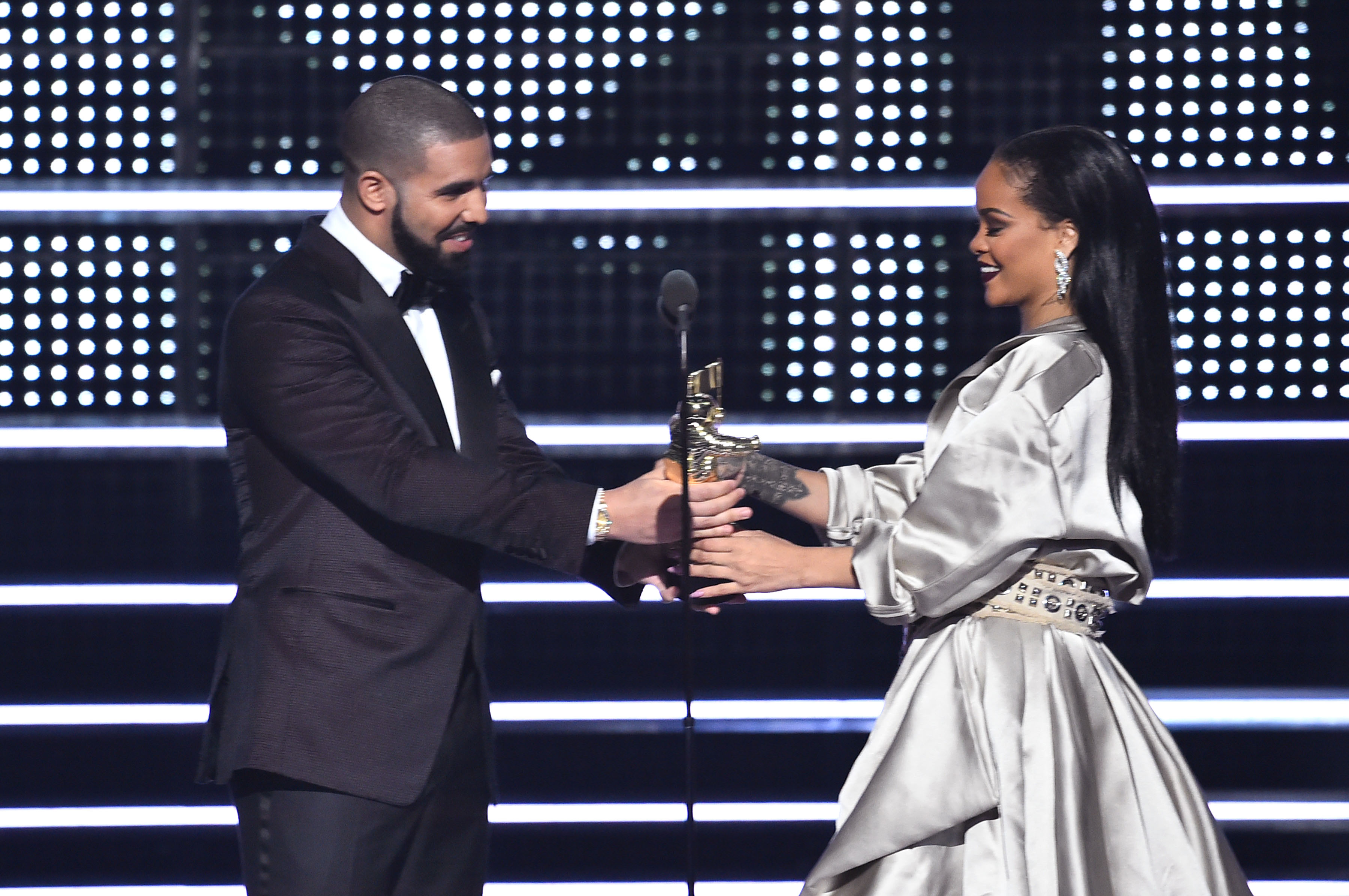 NEW YORK, NY - AUGUST 28:  Drake presents Rihanna with the The Video Vanguard Award during the 2016 MTV Video Music Awards at Madison Square Garden on August 28, 2016 in New York City.