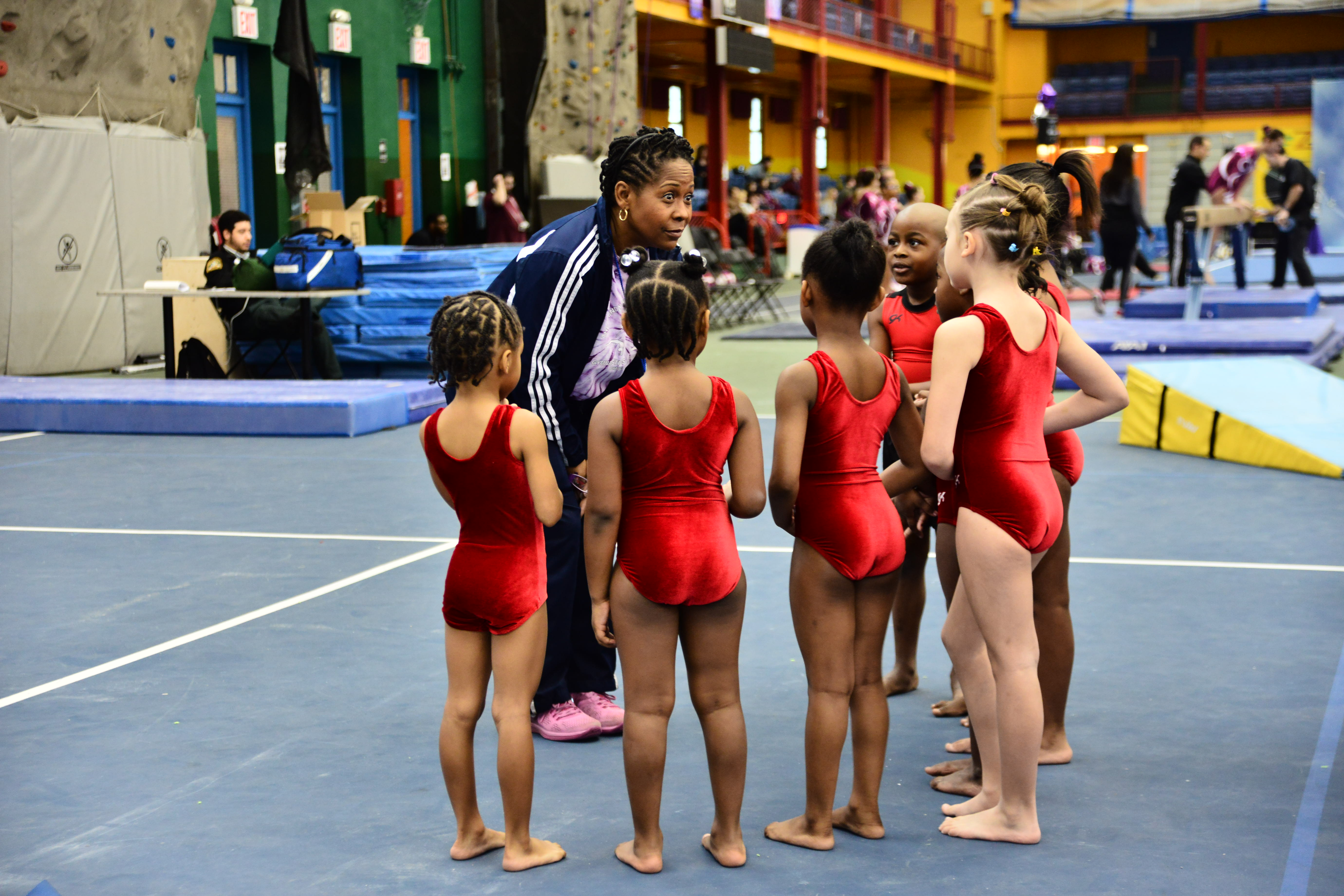 Hall of Fame Rhythmic Gymnast Wendy Hilliard holds a pep talk with some of her young students at the Harlem Gymnastics Invitational held on Feb. 21 at the Harlem Armory.