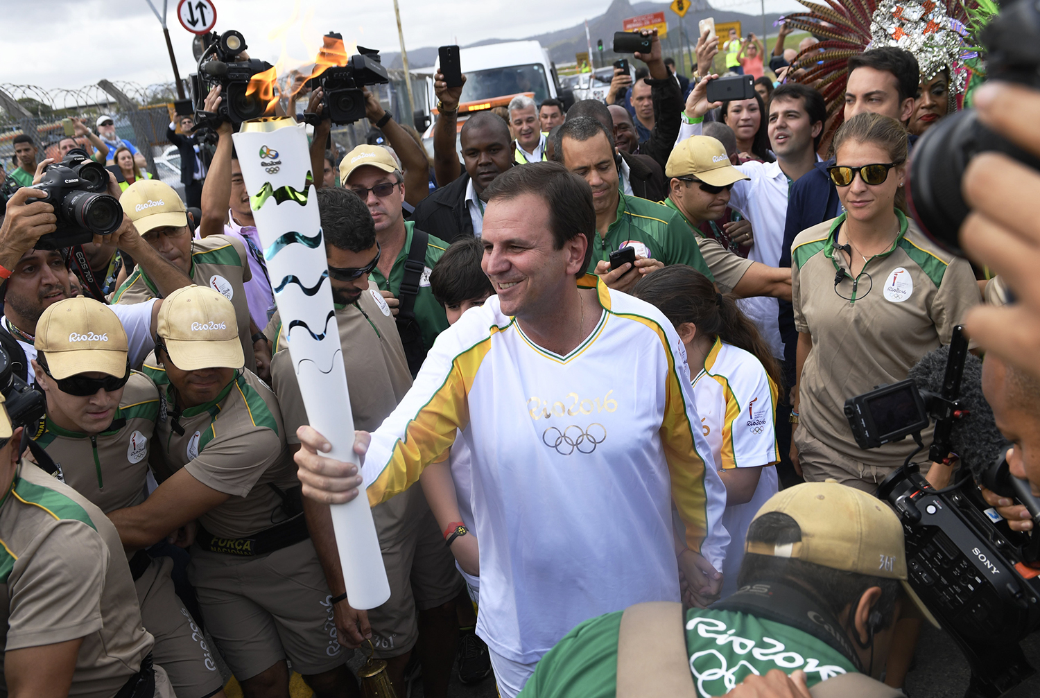 Eduardo Paes, mayor of Rio de Janeiro, carries the Olympic torch during a relay in the Brazilian host city on Aug. 3, 2016.
