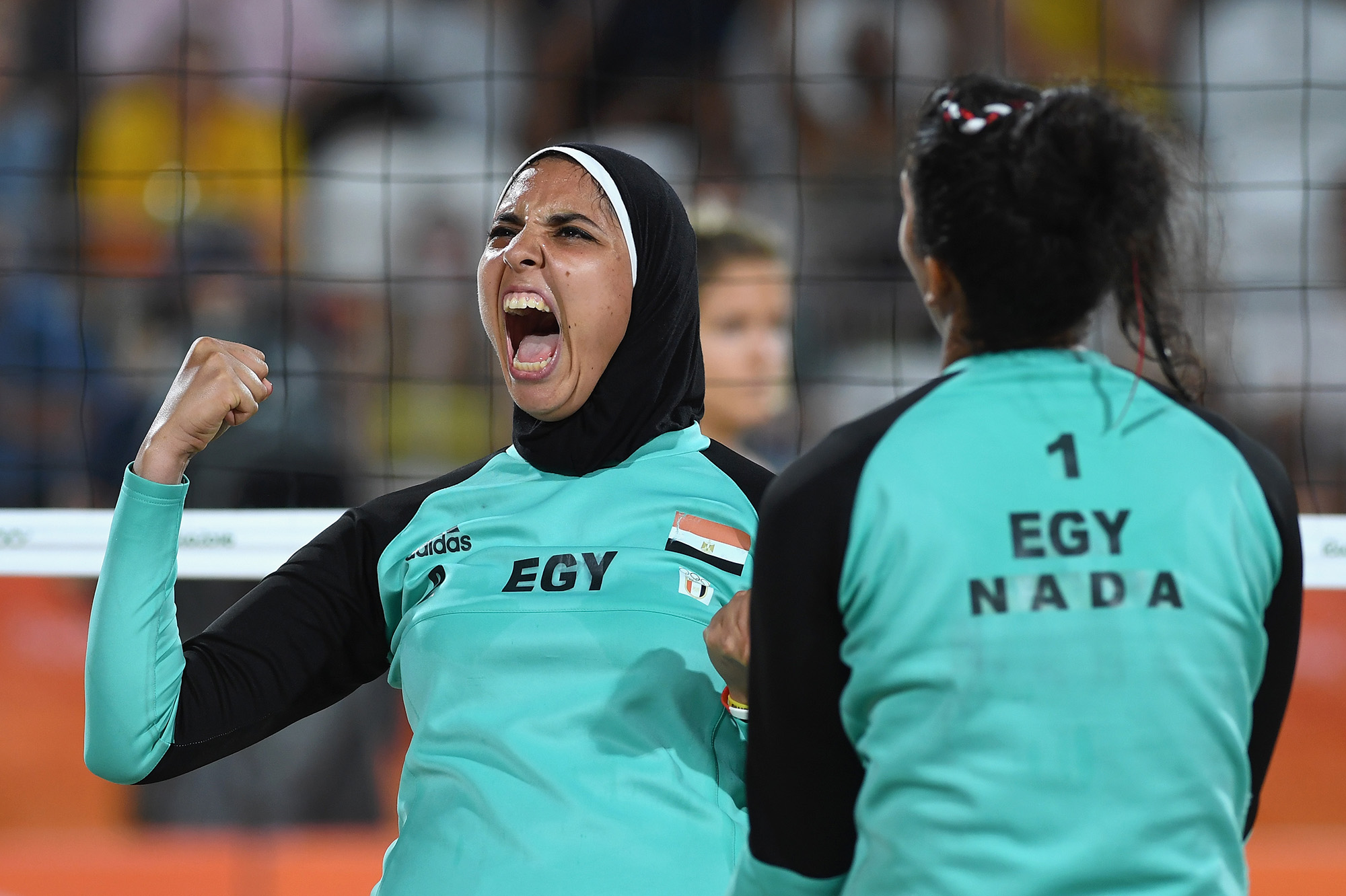 Doaa Elghobashy of Egypt reacts during the Women's Beach Volleyball preliminary round Pool D match against Laura Ludwig and Kira Walkenhorst of Germany on Day 2 of the Rio 2016 Olympic Games at the Beach Volleyball Arena on August 7, 2016 in Rio de Janeiro, Brazil.  (Photo by Shaun Botterill/Getty Images)