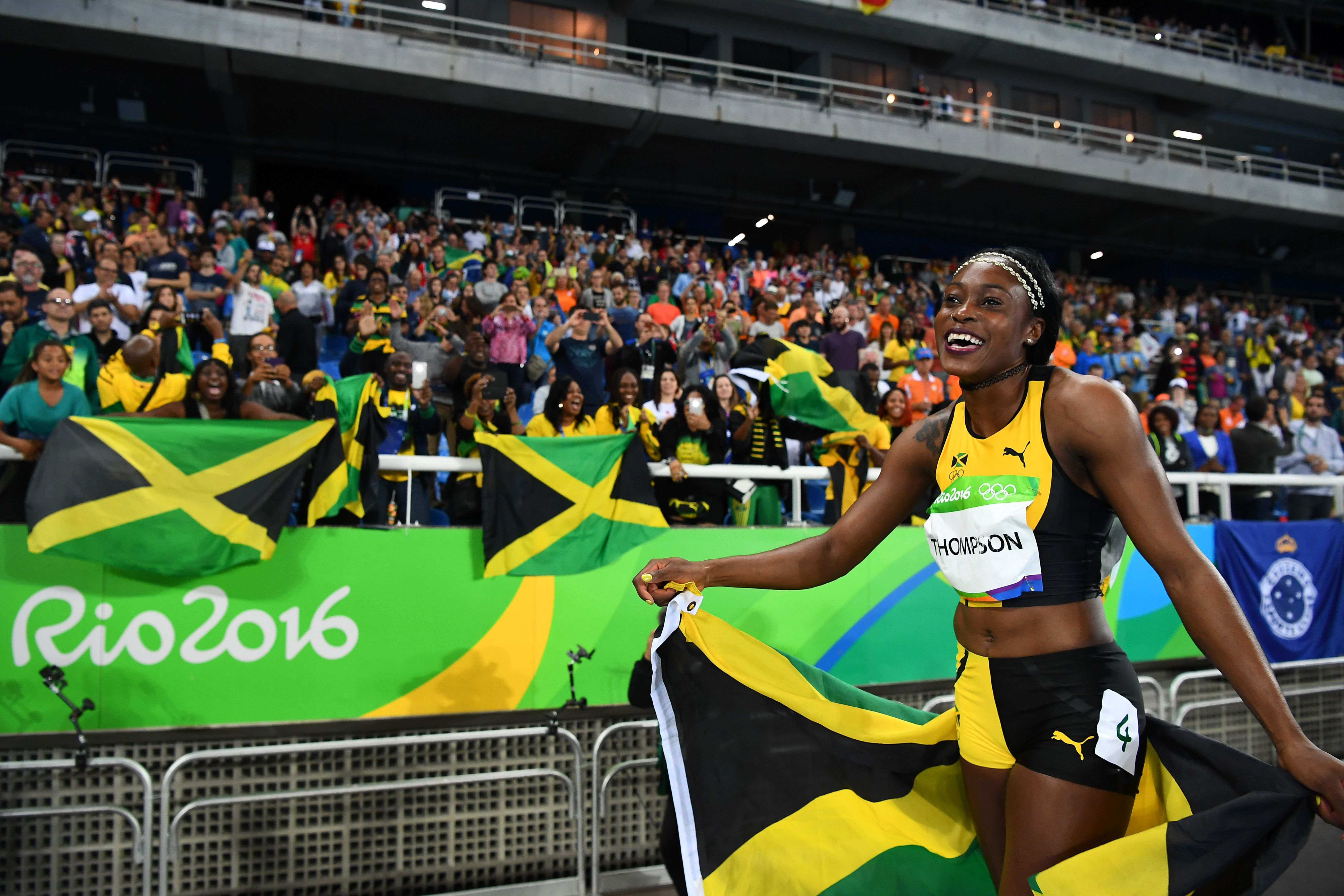Jamaica's Elaine Thompson celebrates after she won the Women's 100m Final during the athletics event at the Rio 2016 Olympic Games at the Olympic Stadium in Rio de Janeiro on August 13, 2016.