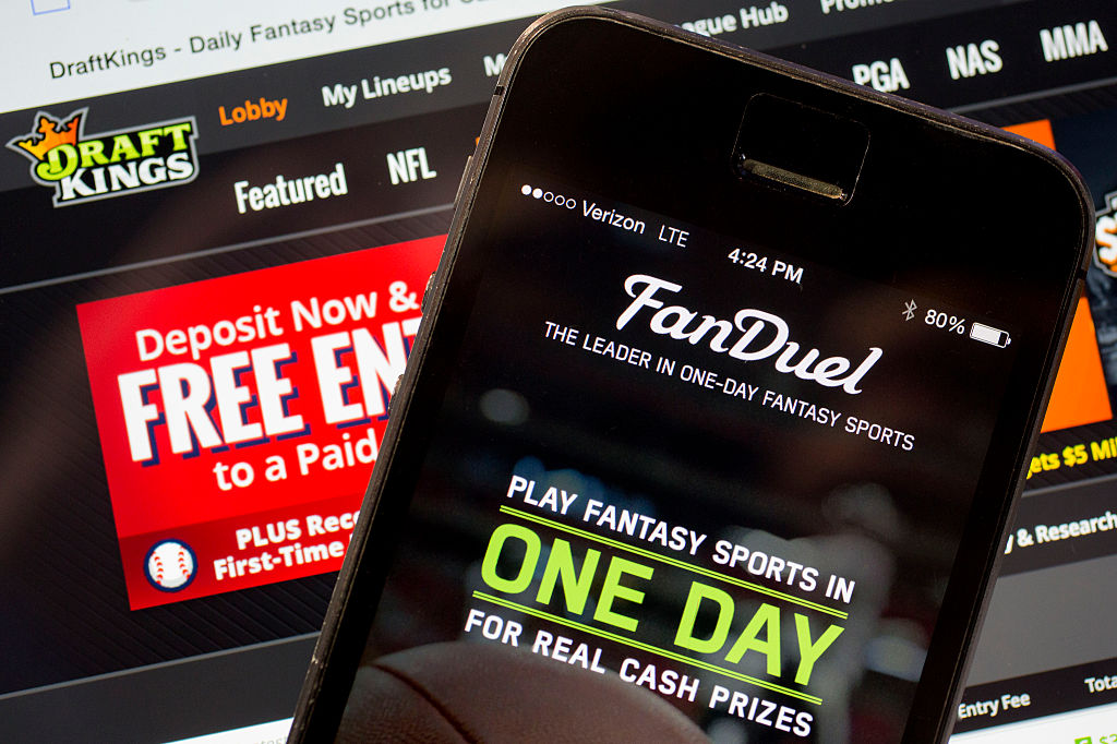 The FanDuel Inc. app and DraftKings Inc. website are arranged for a photograph in Washington, D.C. on Oct. 5, 2015.