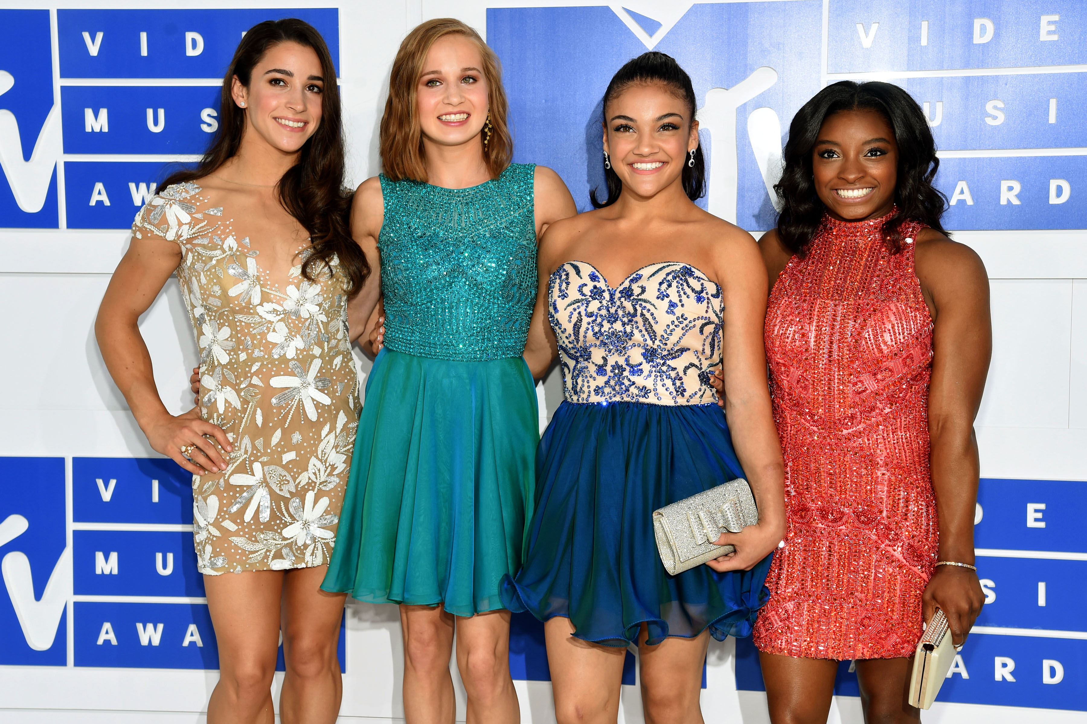 NEW YORK, NY - AUGUST 28:  (R-L) Olympic gymnasts Aly Raisman, Madison Kocian, Laurie Hernandez and Simone Biles attend the 2016 MTV Video Music Awards at Madison Square Garden on August 28, 2016 in New York City.  (Photo by Jamie McCarthy/Getty Images)