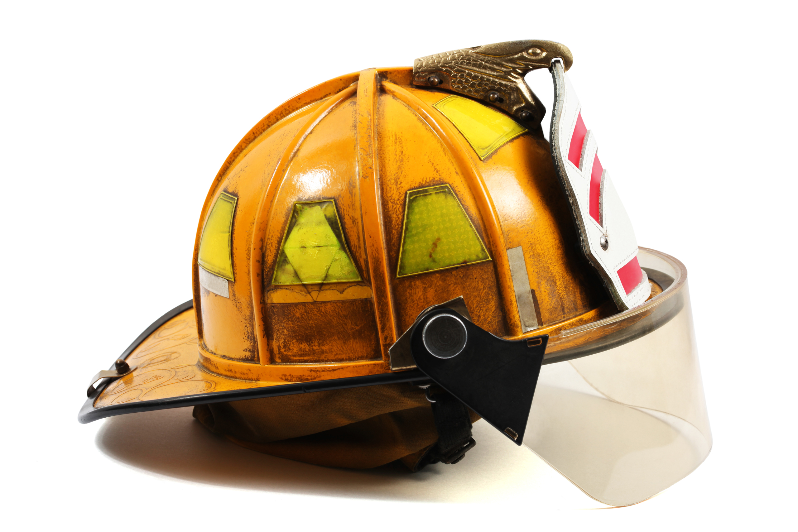 Yellow firefighter's helmet with firefighter shield.