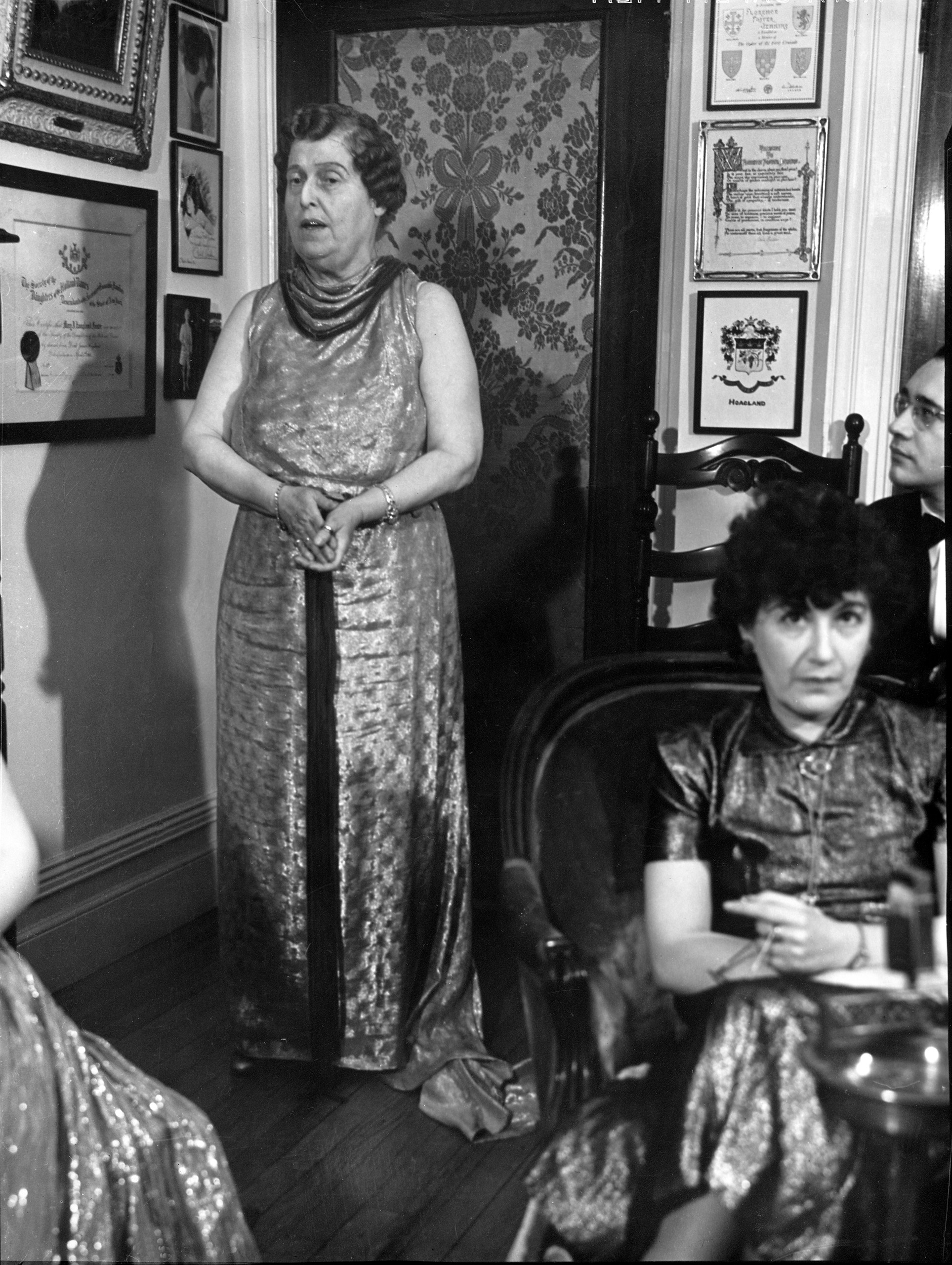 Florence Foster Jenkins (L) entertaining her socialite guests at a formal party in her home in 1937.