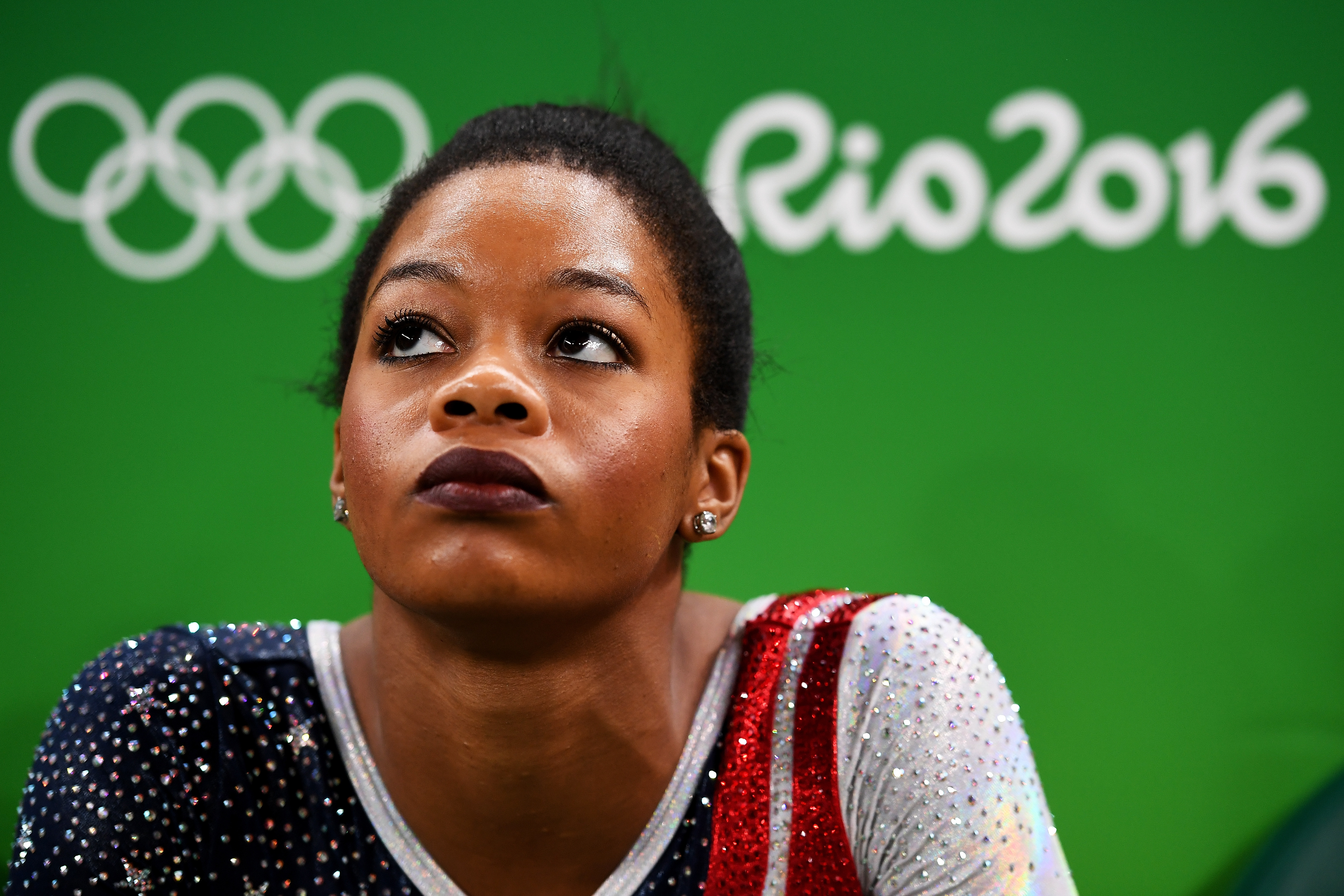 Gabby Douglas  looks on during the Artistic Gymnastics Women's Team Final on Day 4 of the Rio 2016 Olympic Games on Aug. 9, 2016