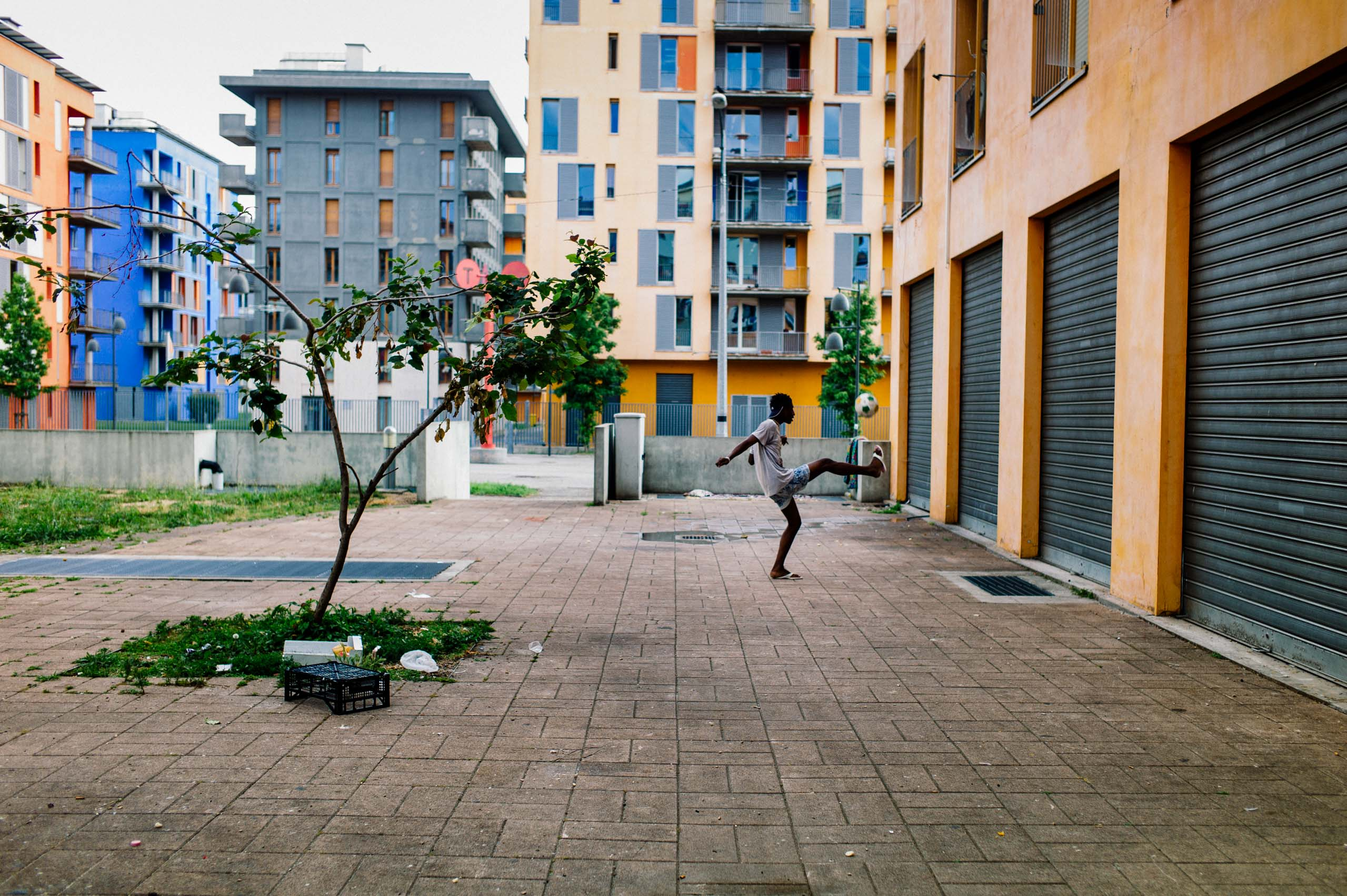 The Olympic Village in Turin, host of the 2006 Winter Olympics, photographed in June 2016. After sitting empty for years, the buildings became a home for squatters and later for more than 1,000 migrants and refugees, many from Africa.
