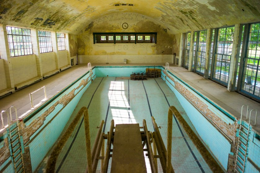 The empty swimming pool at the Olympic Village located west of Berlin, which hosted the 1936 Olympics, in the town of Elstal. After WWII it was occupied by the Soviet army and used by them until their withdrawal in 1992. The dining hall, the swimming pool, and the gymnasium still stand, along with the ruins of dozens of abandoned housing buildings. After decades of neglect, there is an effort underway to restore the premises as a historic site.