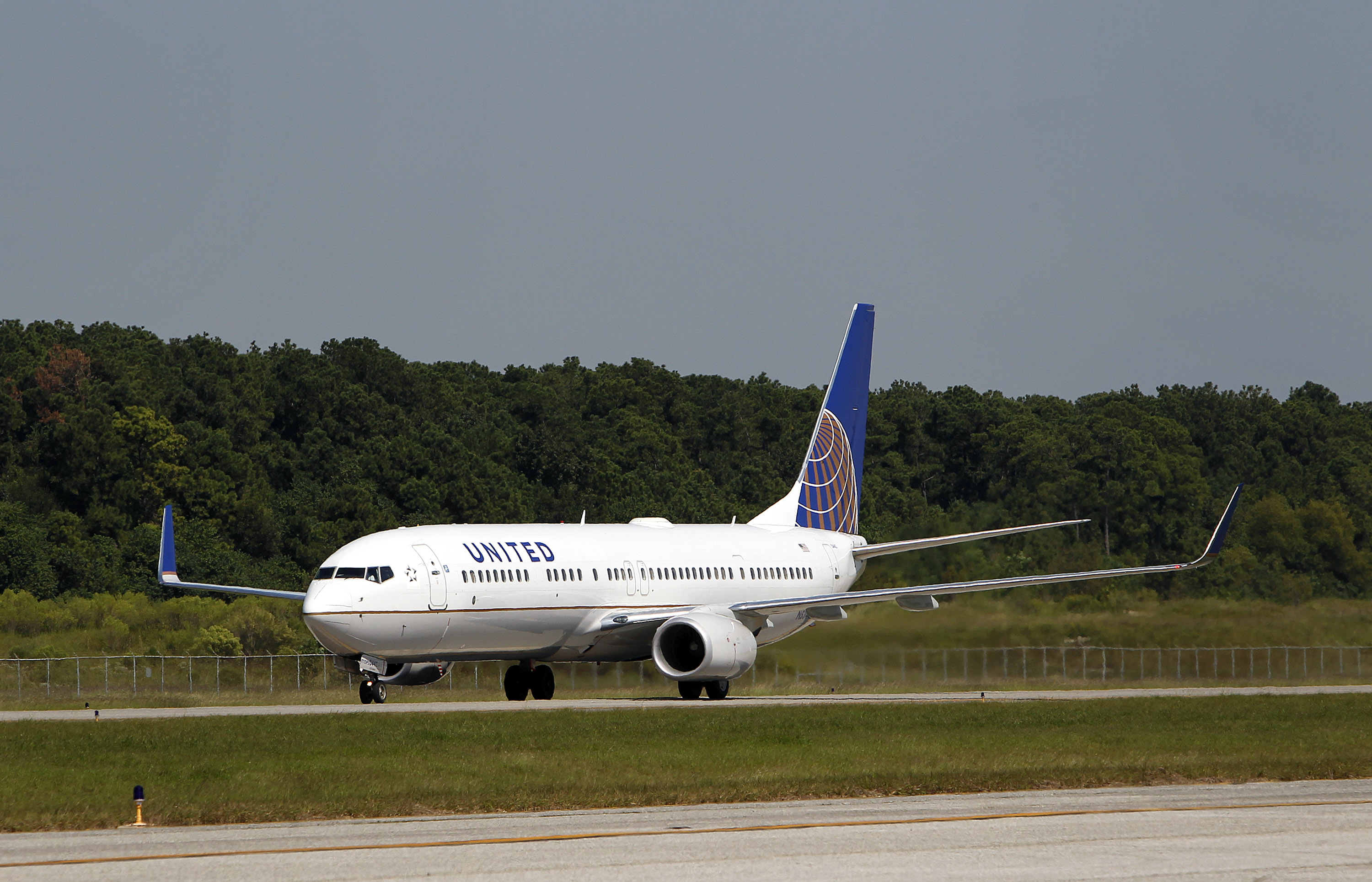 A Boeing Co. 737-924 extended range jet (N53442) bearing United Airlines livery and the Continental Airlines logo at George Bush Intercontinental Airport in Houston, Texas, U.S., on Oct. 1, 2010.