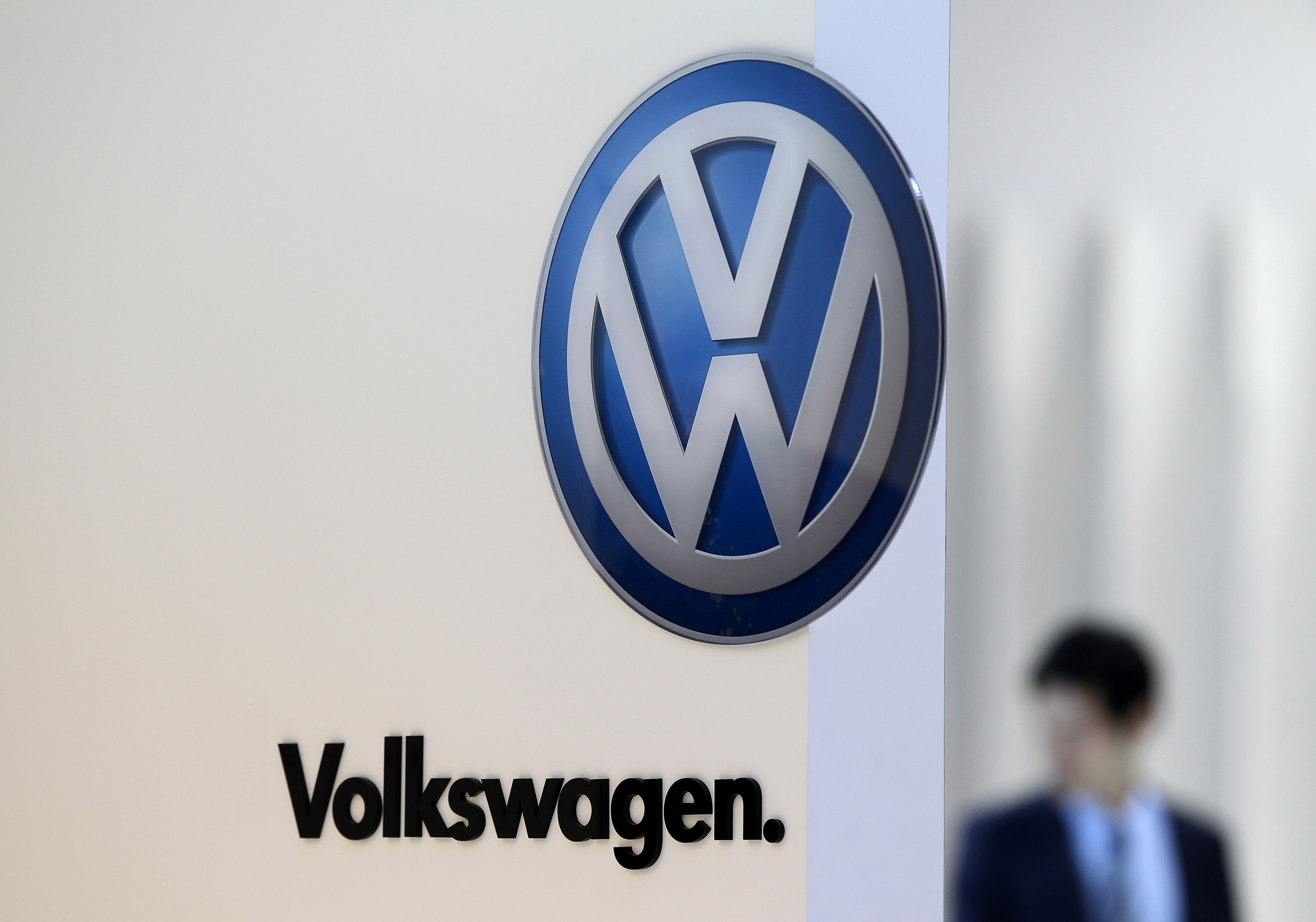 The Volkswagen AG logo is displayed at the company's booth during the media preview of the 2012 Busan International Motor Show in Busan, South Korea, on May 24, 2012.