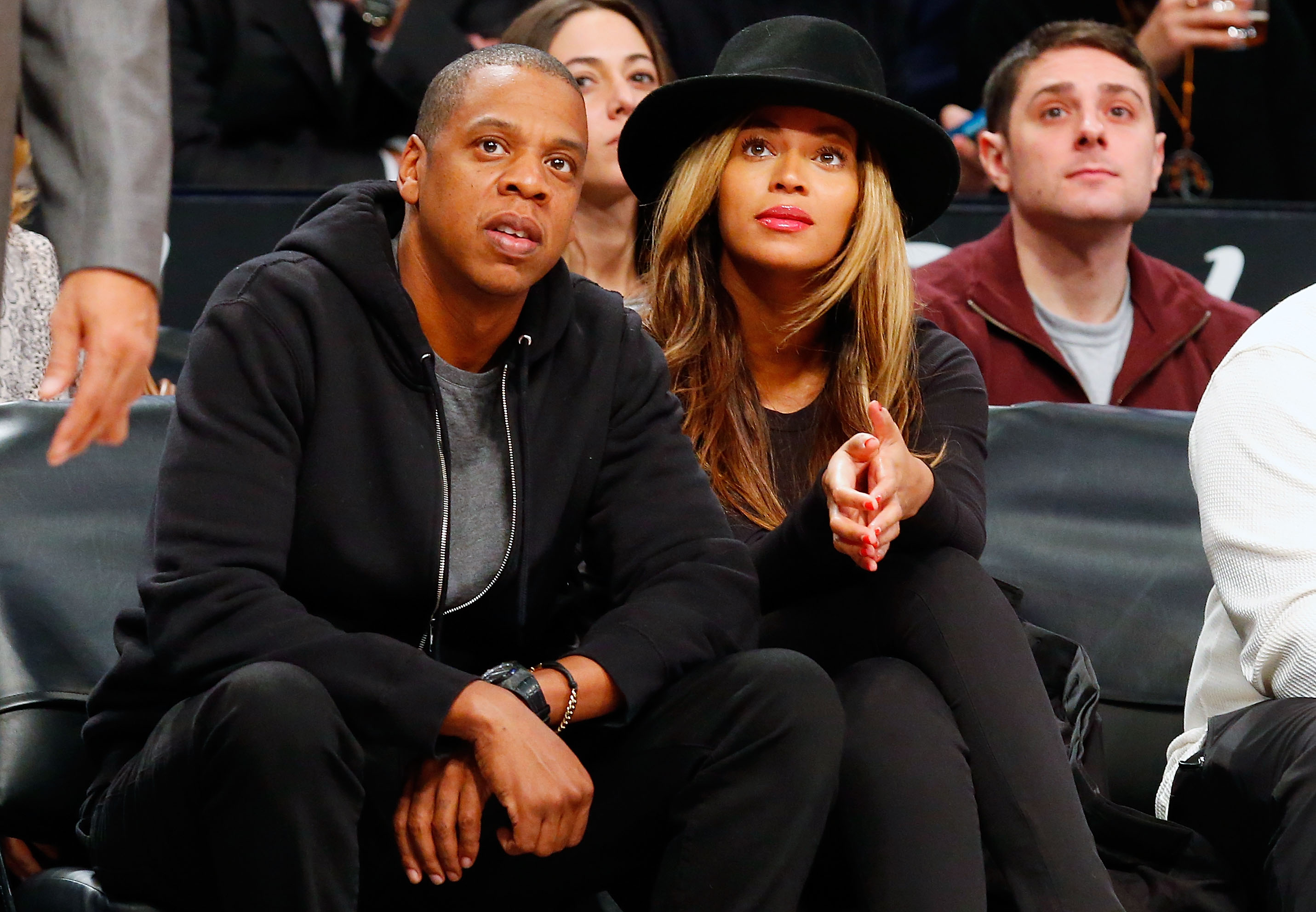 Jay-Z and Beyonce attend a game between the Brooklyn Nets and the Houston Rockets at Barclays Center on January 12, 2015 (Photo by Jim McIsaac/Getty Images)