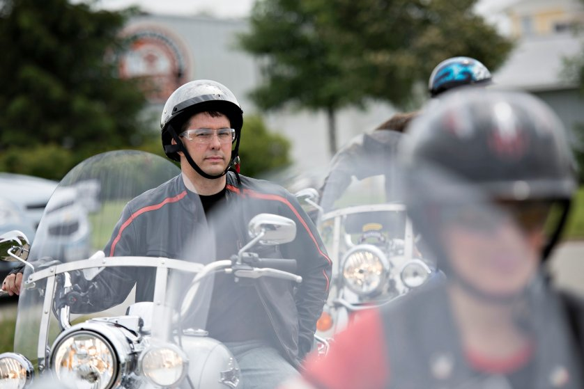 Scott Walker, governor of Wisconsin, sits on a Harley Davidson motorcycle as he awaits the start of a group ride at Big Barn Harley Davidson in Des Moines, Iowa, U.S., on Saturday, June 6, 2015.