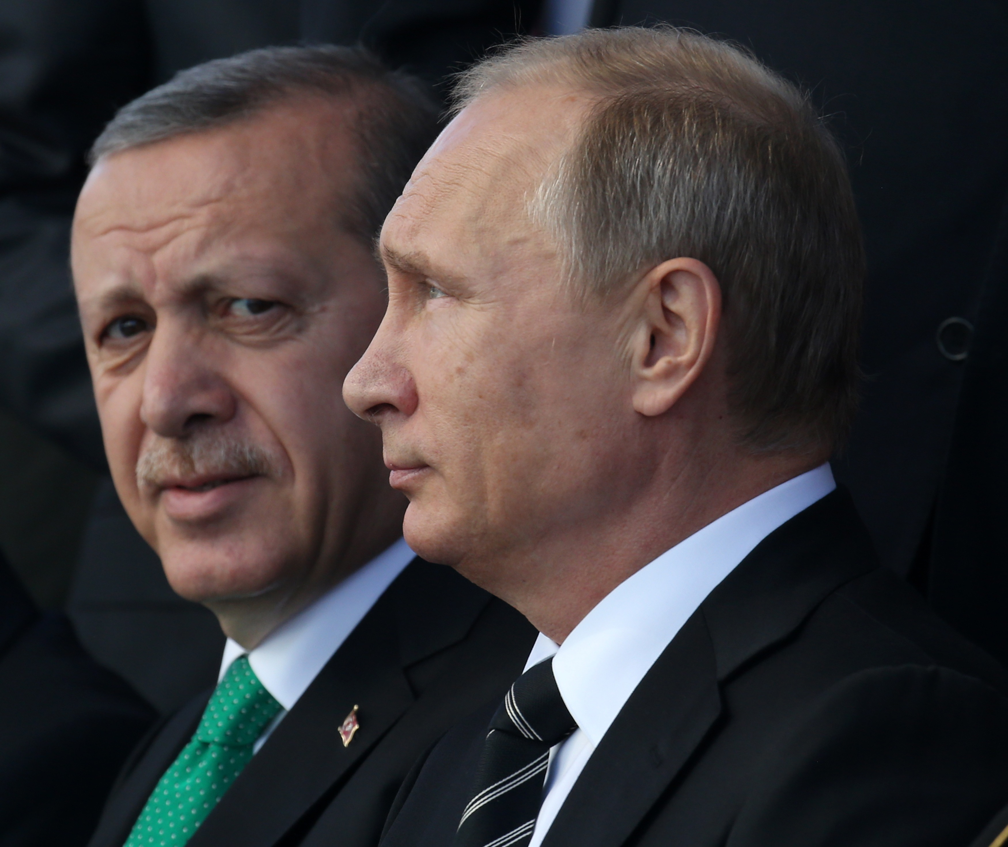 Russian President Vladimir Putin, right, and Turkish President Recep Tayyip Erdogan attend an opening ceremony for the newly restored Moscow Cathedral Mosque in Moscow on Sept. 23, 2015