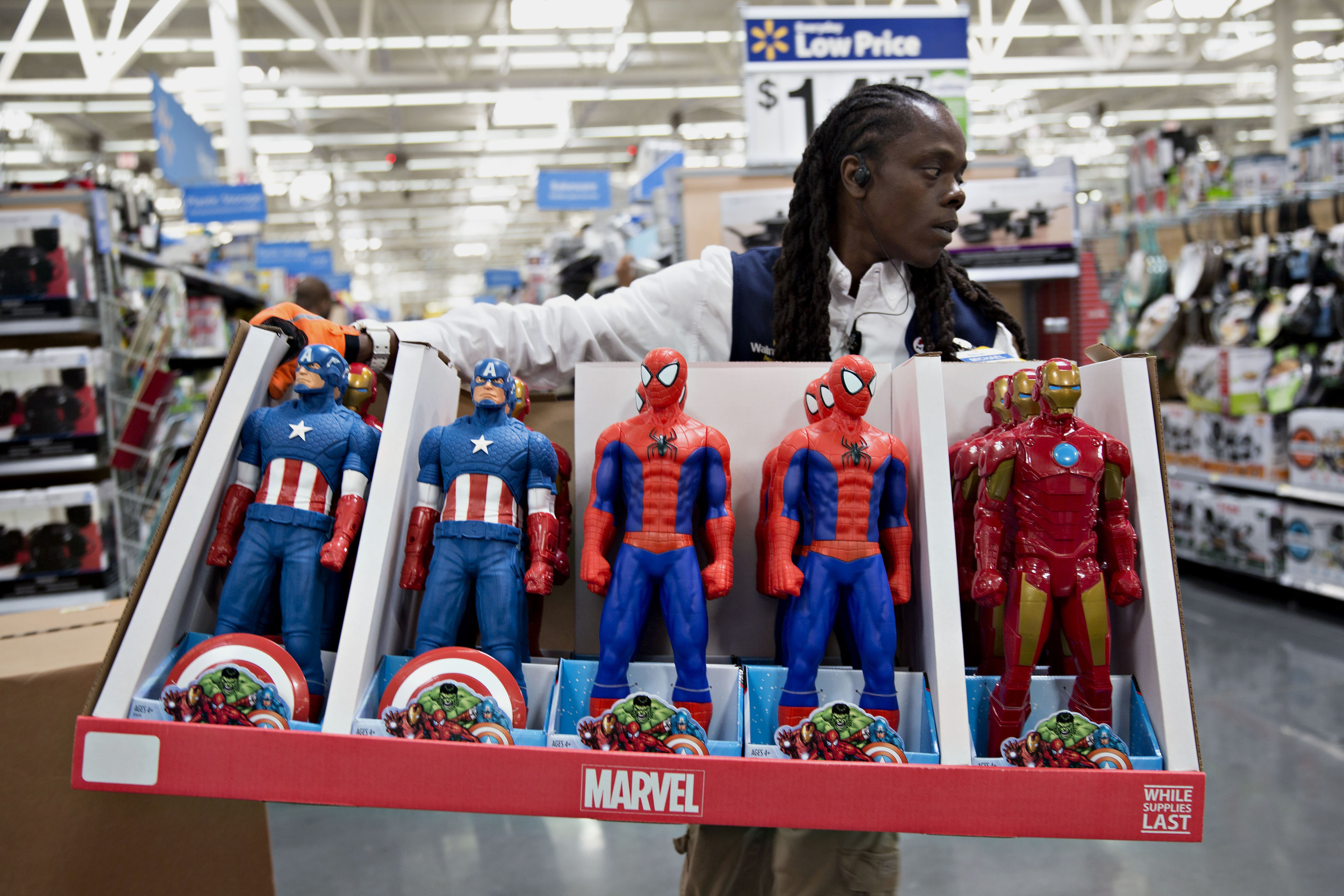 An employee moves Marvel Entertainment LLC action figures in preparation for Black Friday at a Wal-Mart Stores Inc. location in Chicago, Illinois, U.S., on Wednesday, Nov. 25, 2015.