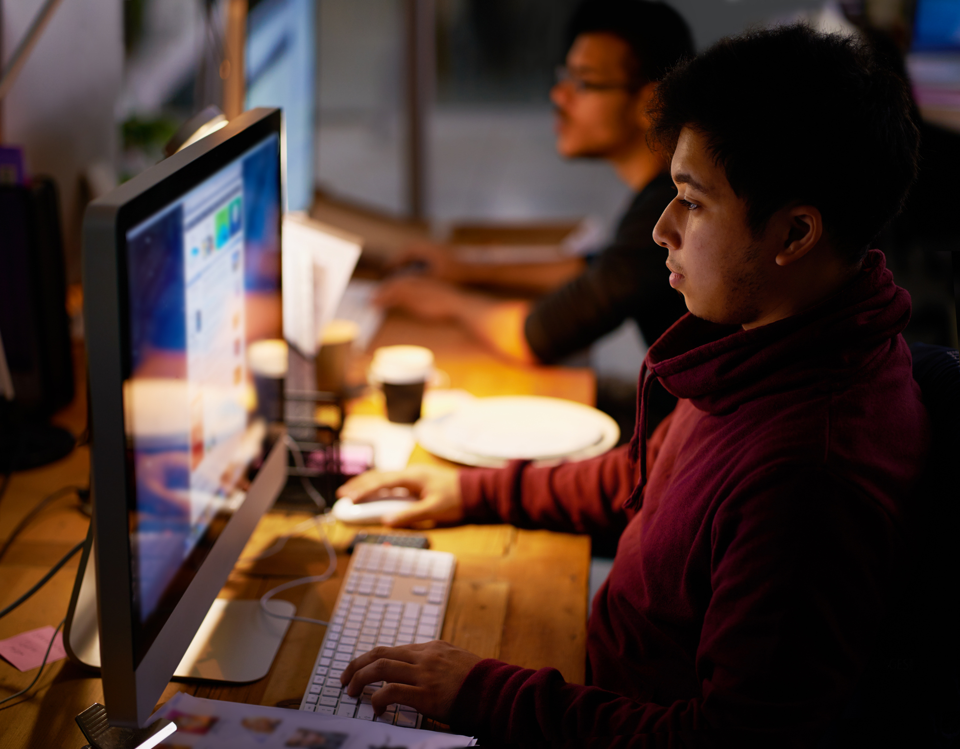Cropped shot of a group of young coworkers working in a dimly-lit officehttp://195.154.178.81/DATA/i_collage/pi/shoots/783867.jpg
