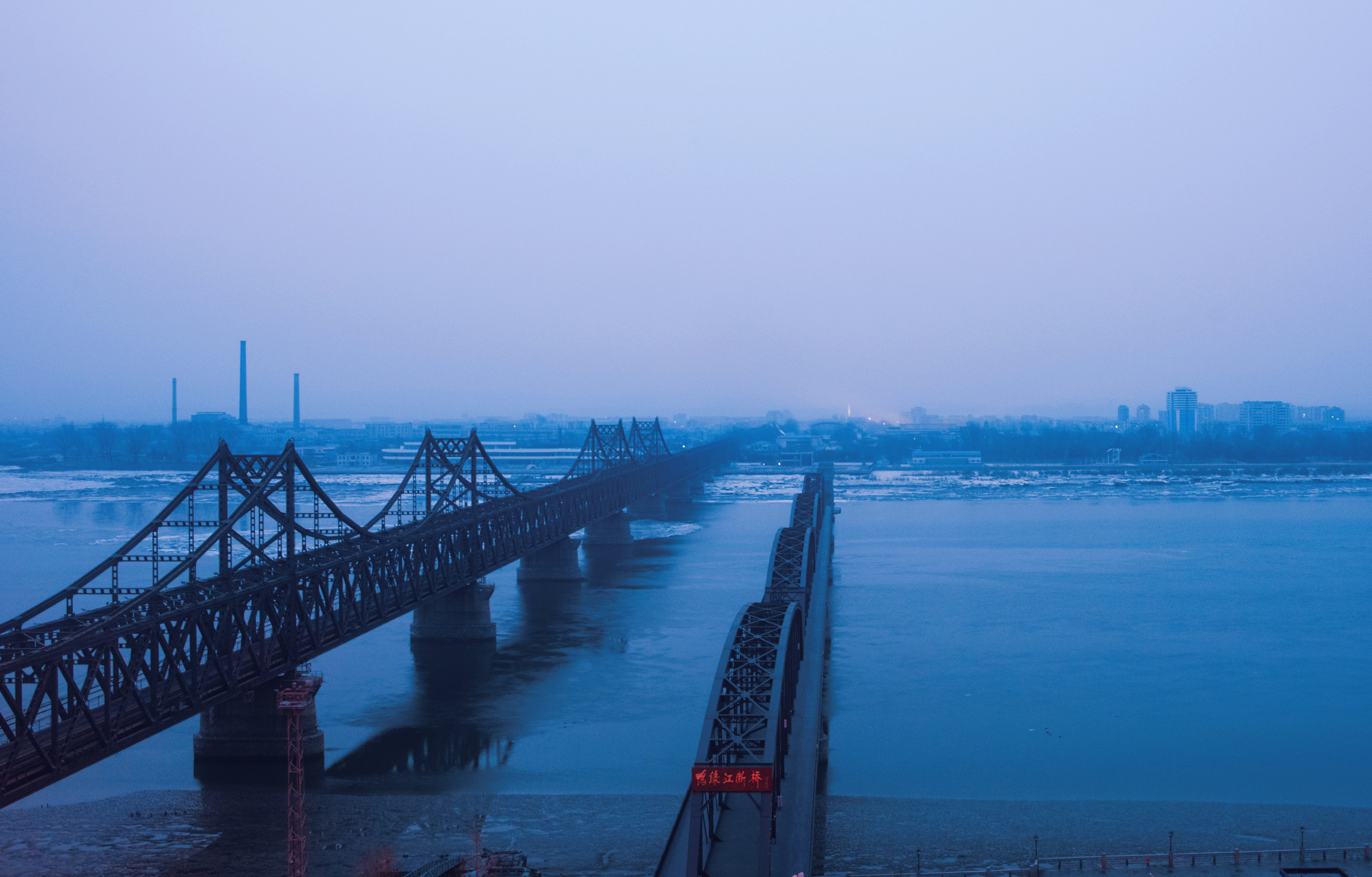 Fog is seen on the banks of the Yalu River in the Chinese border town of Dandong, opposite to the North Korean town of Sinuiju, on February 8, 2016. The UN Security Council strongly condemned North Korea's rocket launch on February 7 and agreed to move quickly to impose new sanctions that will punish Pyongyang for  these dangerous and serious violations.