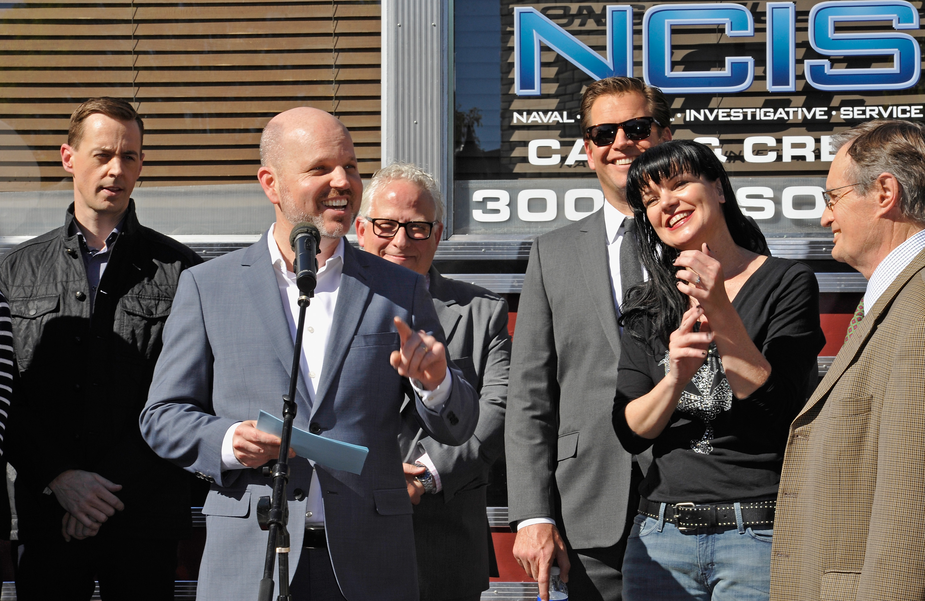 Actor Sean Murray, executive producers Glenn Geller and Gary Glasberg and actors Michael Weatherly, Pauley Perrette and David McCallum attend the cake cutting celebration for  NCIS  300th episode on February 9, 2016 in Valencia, Calif.