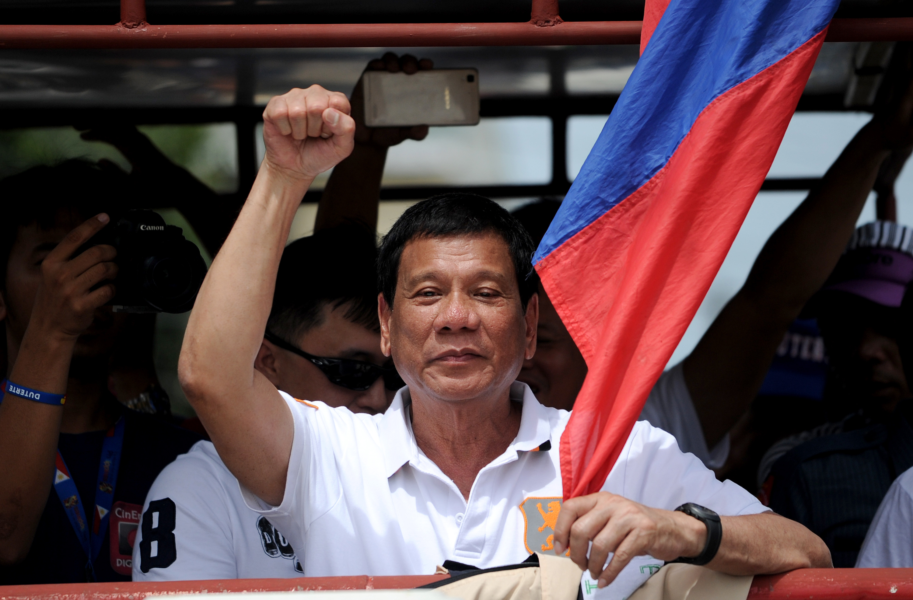 Philippine President Rodrigo Duterte raises a clenched fist during his campaign sortie in Lingayen, Pangasinan, north of Manila, on March 2, 2016