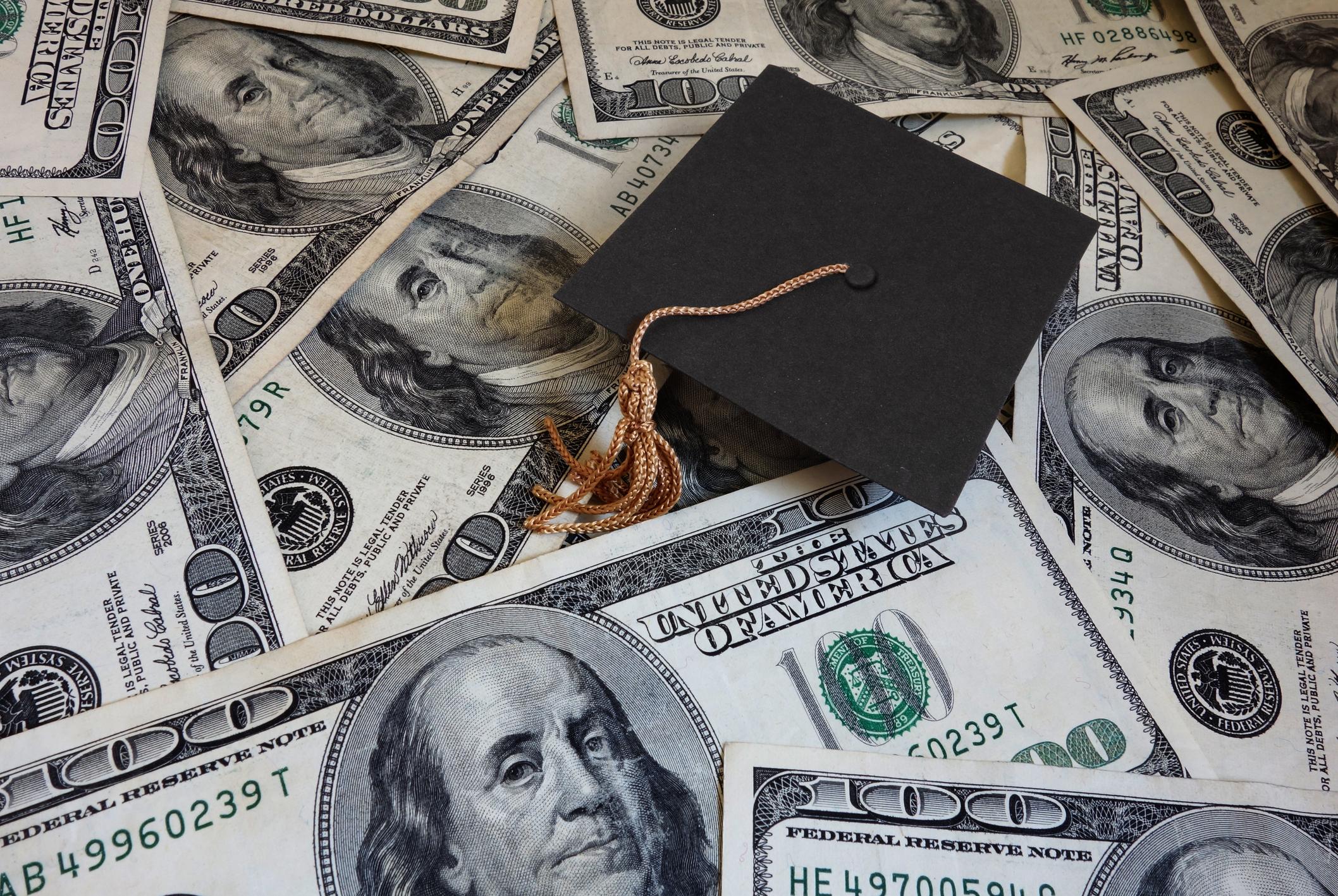 Miniature graduation cap on assorted cash