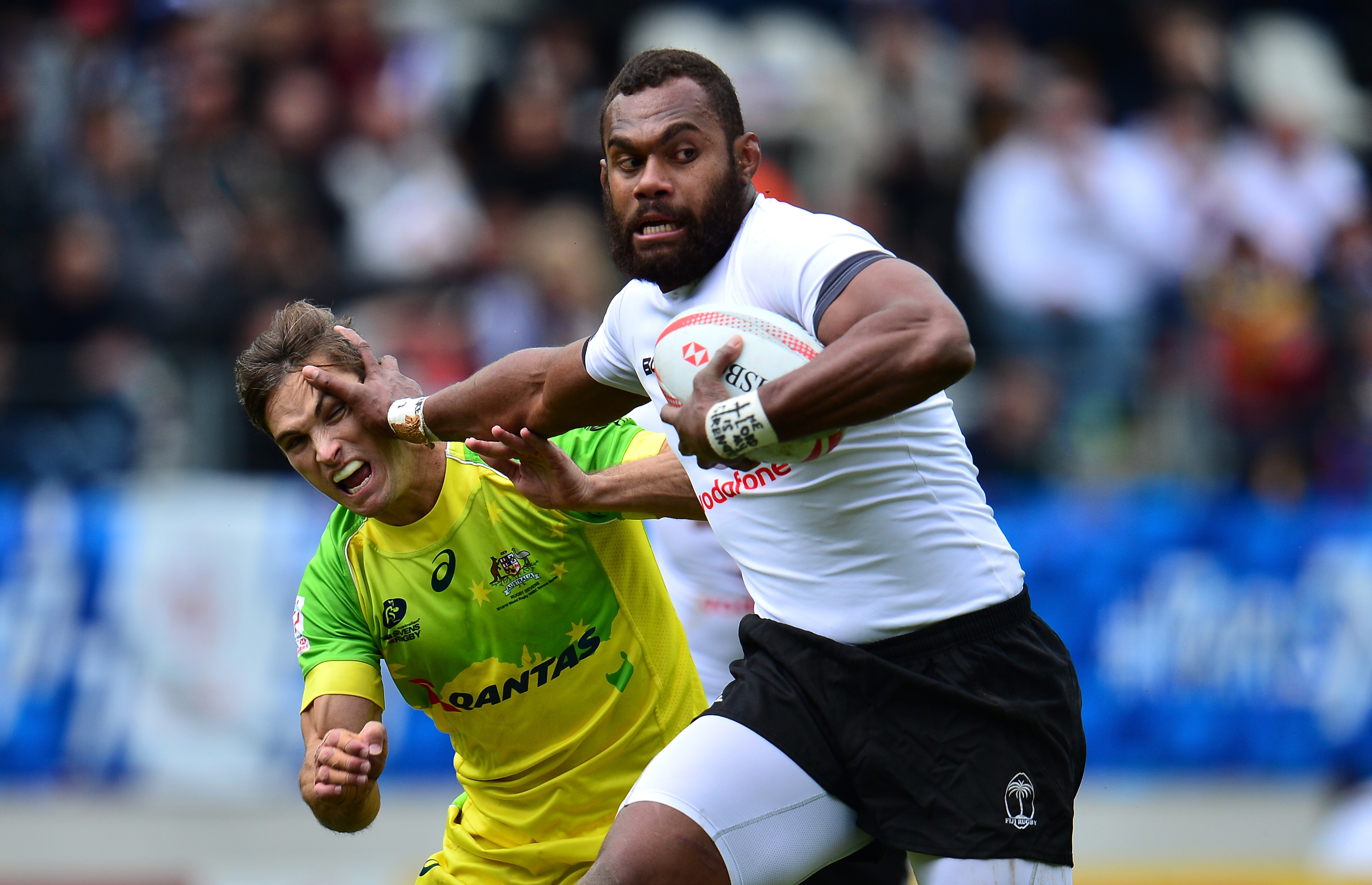 Osea Kolinisau of Fiji wards off Edward Jenkins of Australia during the Cup Quarter Final match between Fiji and Australia on day three of the HSBC Paris Sevens at the Stade Jean Bouin on May 15, 2016 in Paris, France.